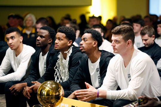 Drew McDonald, right, Jalen Tate, Dantez Walton, and the other members of The Northern Kentucky University Norse wait to hear their fate in the NCAA Tournament.  The Norse earned at No. 14 seed, thus a matchup with a No. 3 seed. Photo shot Sunday March 17, 2019.
