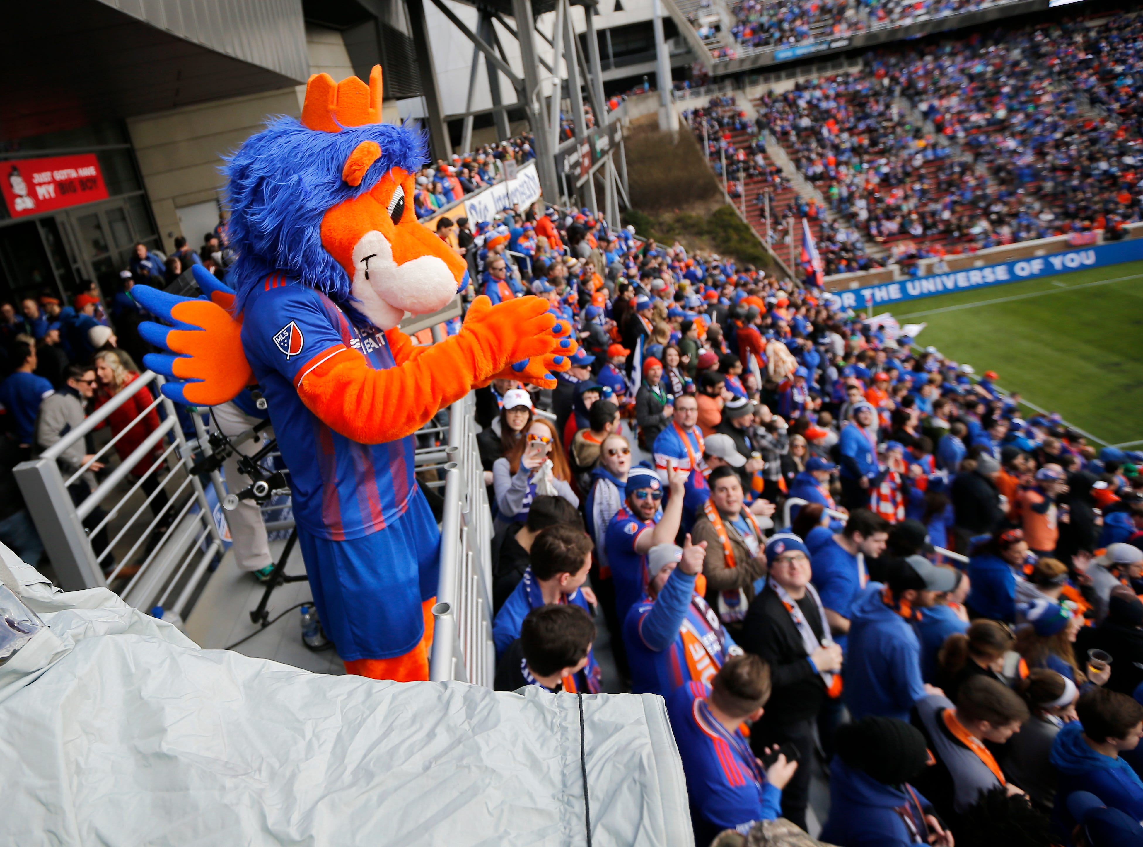 Gary the Lion cheers with fans from the top of the Bailey in the first half of the MLS match between FC Cincinnati and the Portland Timbers at Nippert Stadium in Cincinnati on Sunday, March 17, 2019. FC Cincinnati led 1-0 at halftime.