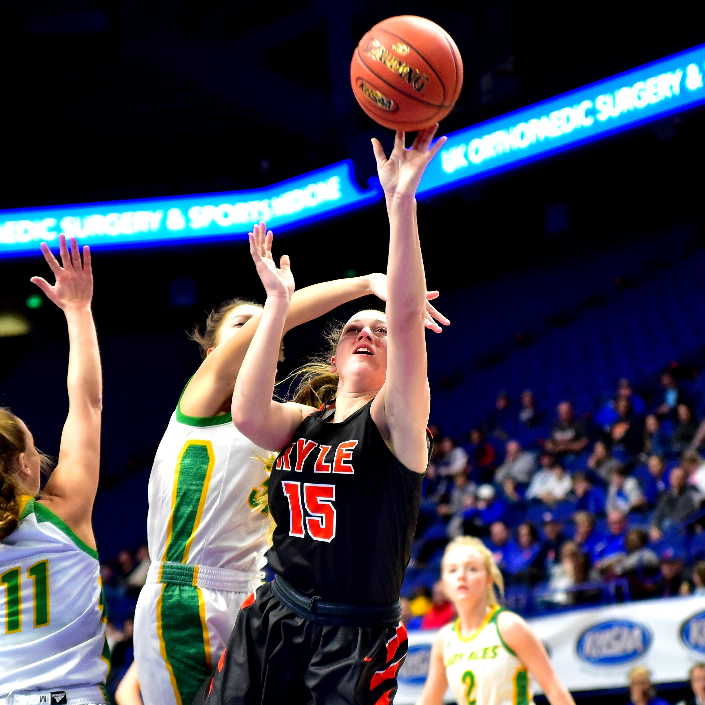 Lauren Schwartz (15) of Ryle powers to the hoop for the Lady Raiders as they top Owensboro Catholic 55-43 to advance to the KHSAA state girls basketball championship game in the KHSAA Girls Sweet 16 at Rupp Arena in Lexington, KY, March 16, 2019.