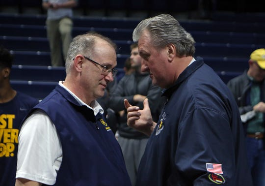Moeller head coach Carl Kremer and West Virginia head coach Bob Huggins meet after the boys regional final against Centerville at the Cintas Center at Xavier University. Moeller defeated Centerville 59-41 and will move on to the Final Four in Columbus.