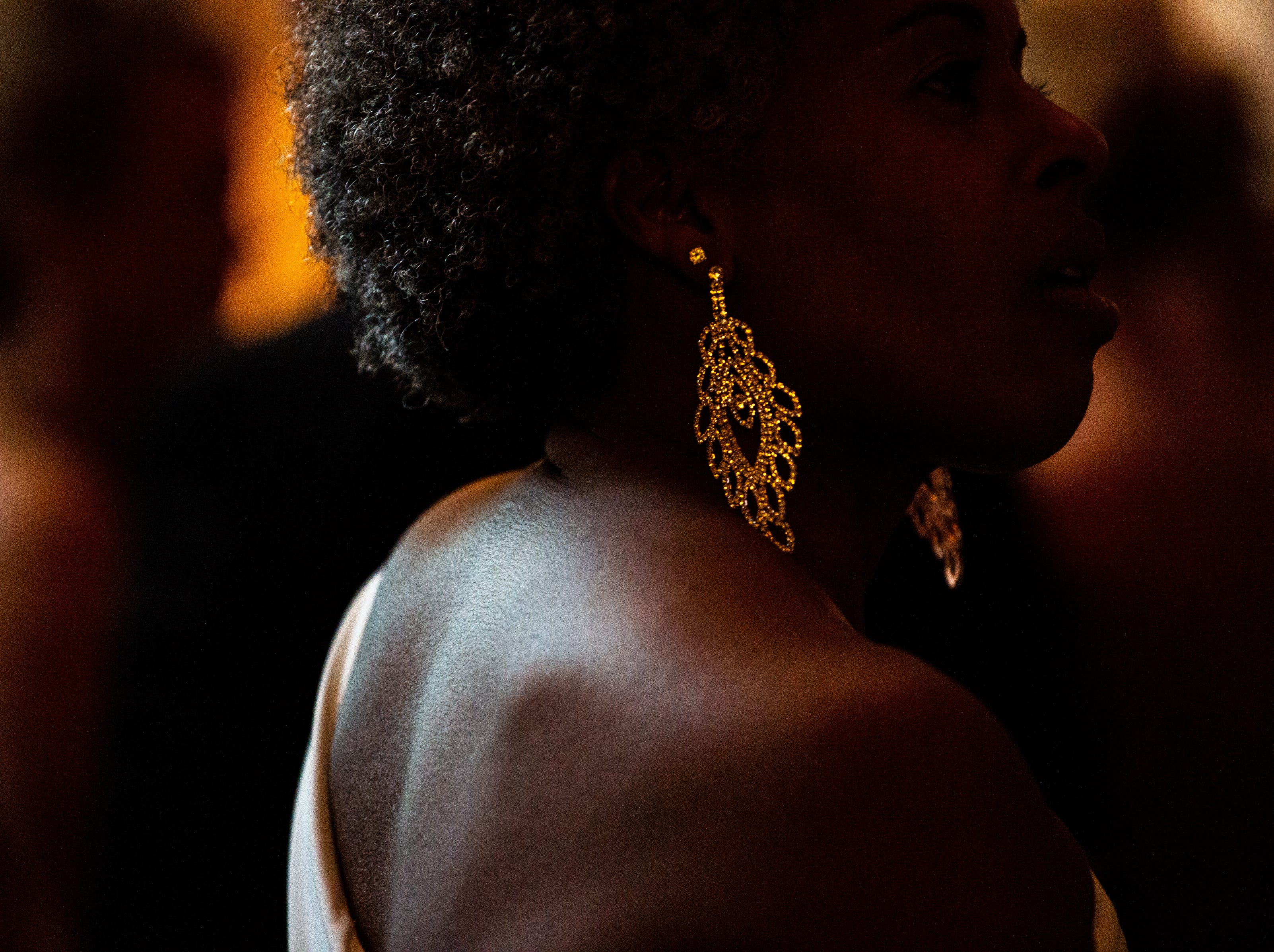 APSU alum and former employee Janet Wilson wears statement earrings during Austin Peay State University's annual Candlelight Ball at the Omni Nashville Hotel Saturday, March 16, 2019, in Nashville, Tenn.