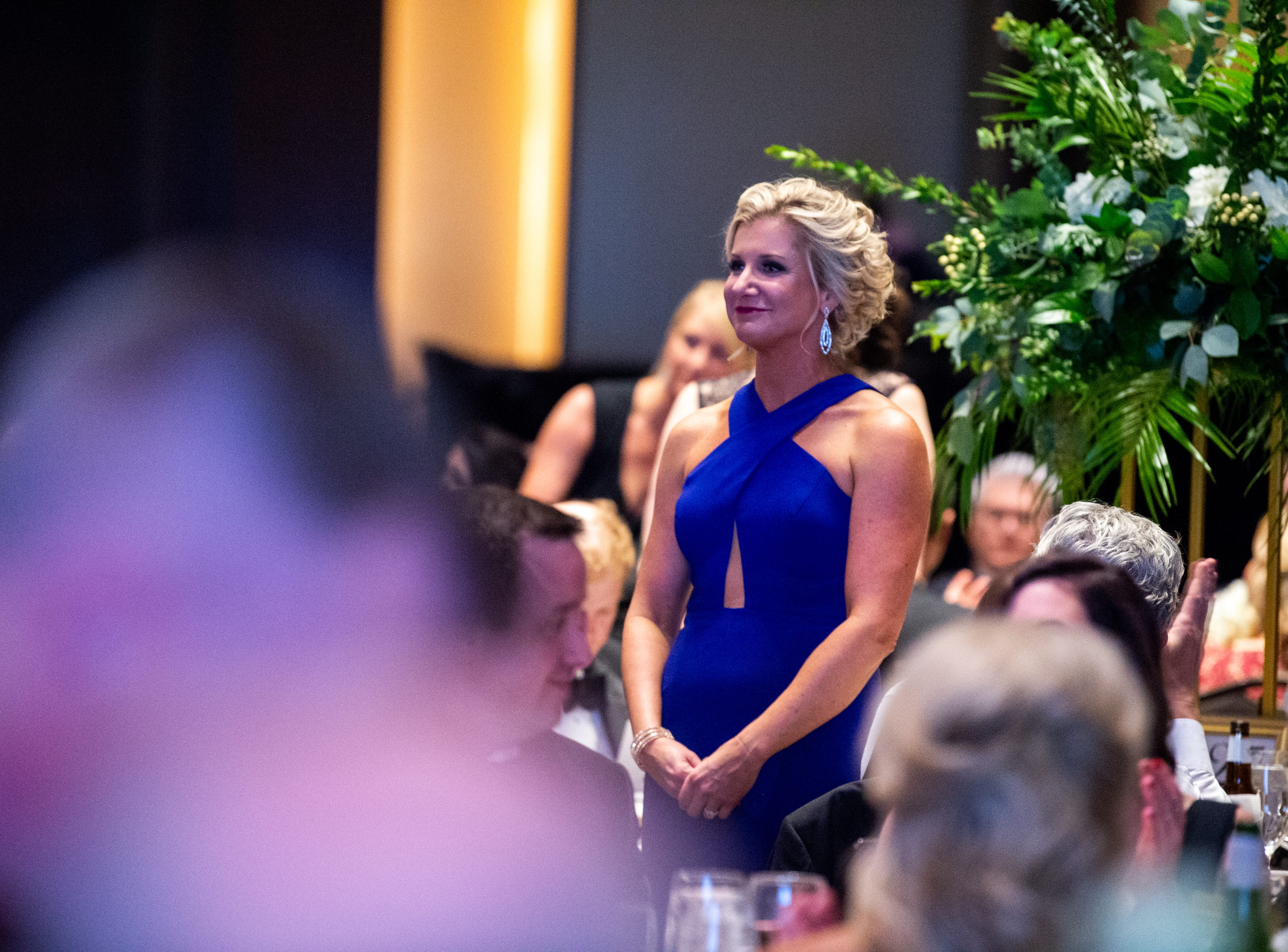 People stand for recognition during Austin Peay State University's annual Candlelight Ball at the Omni Nashville Hotel Saturday, March 16, 2019, in Nashville, Tenn.