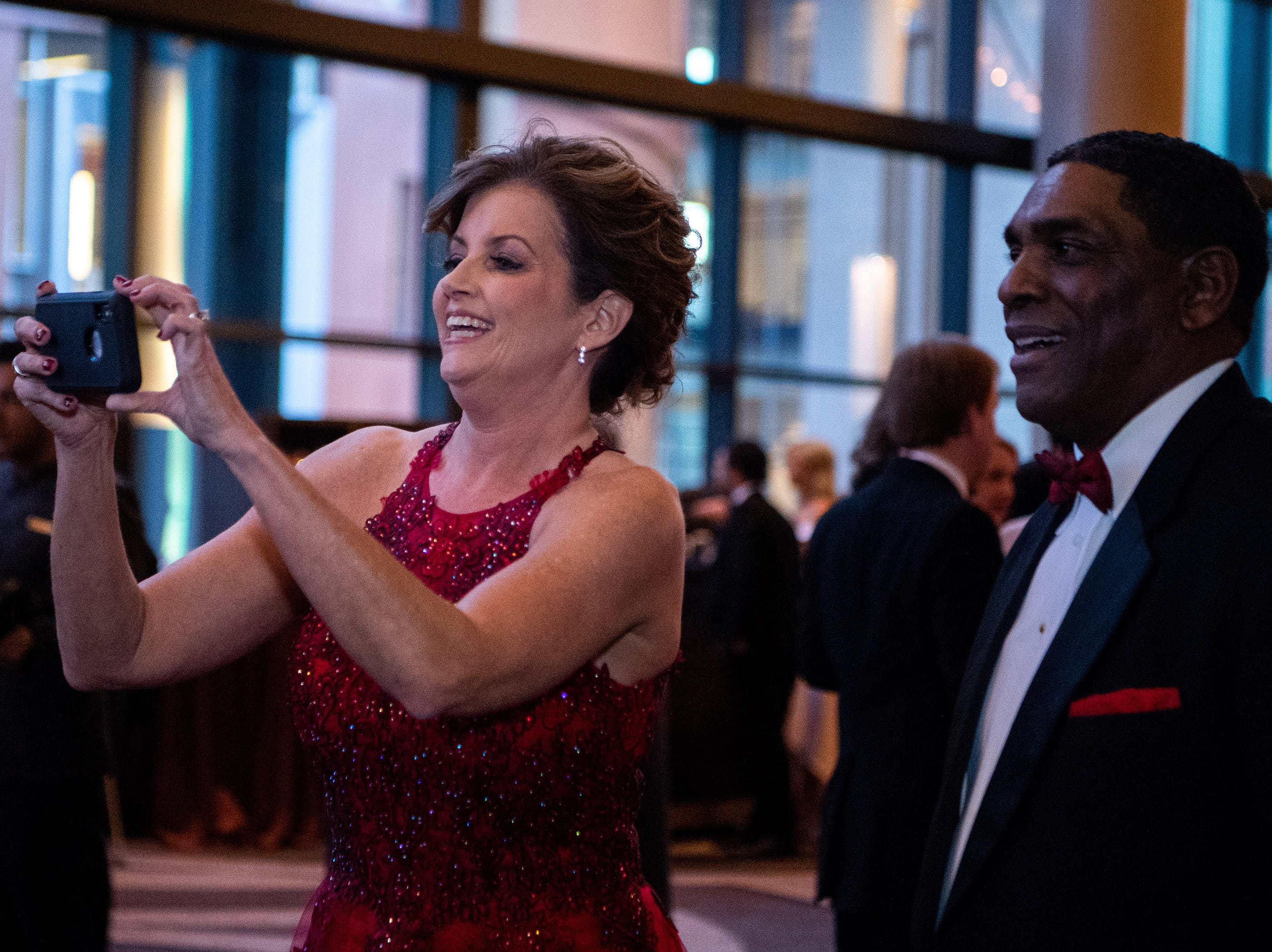 A woman takes a photo during Austin Peay State University's annual Candlelight Ball at the Omni Nashville Hotel Saturday, March 16, 2019, in Nashville, Tenn.