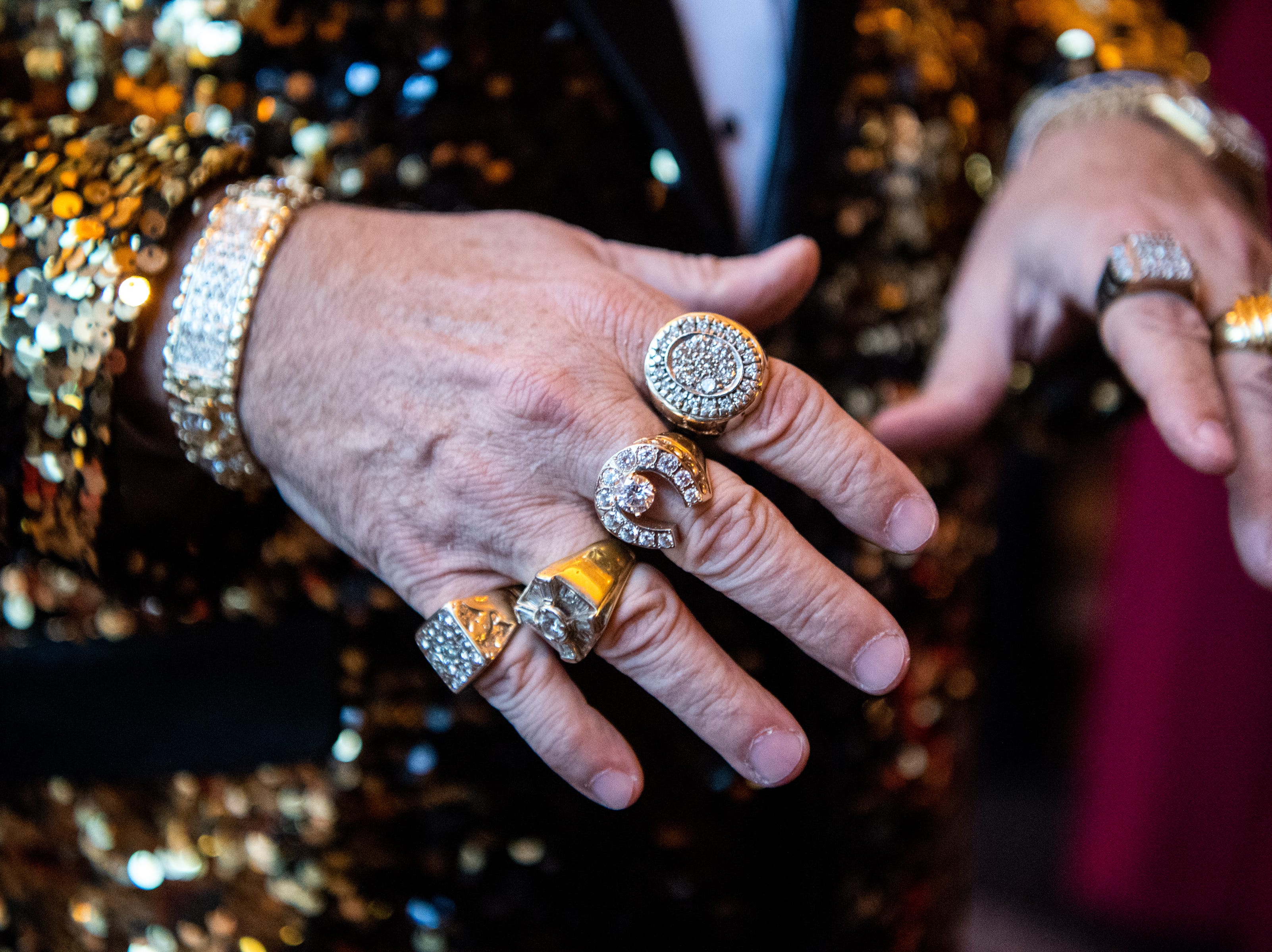 Kevin Kennedy shows off his rings during Austin Peay State University's annual Candlelight Ball at the Omni Nashville Hotel Saturday, March 16, 2019, in Nashville, Tenn.