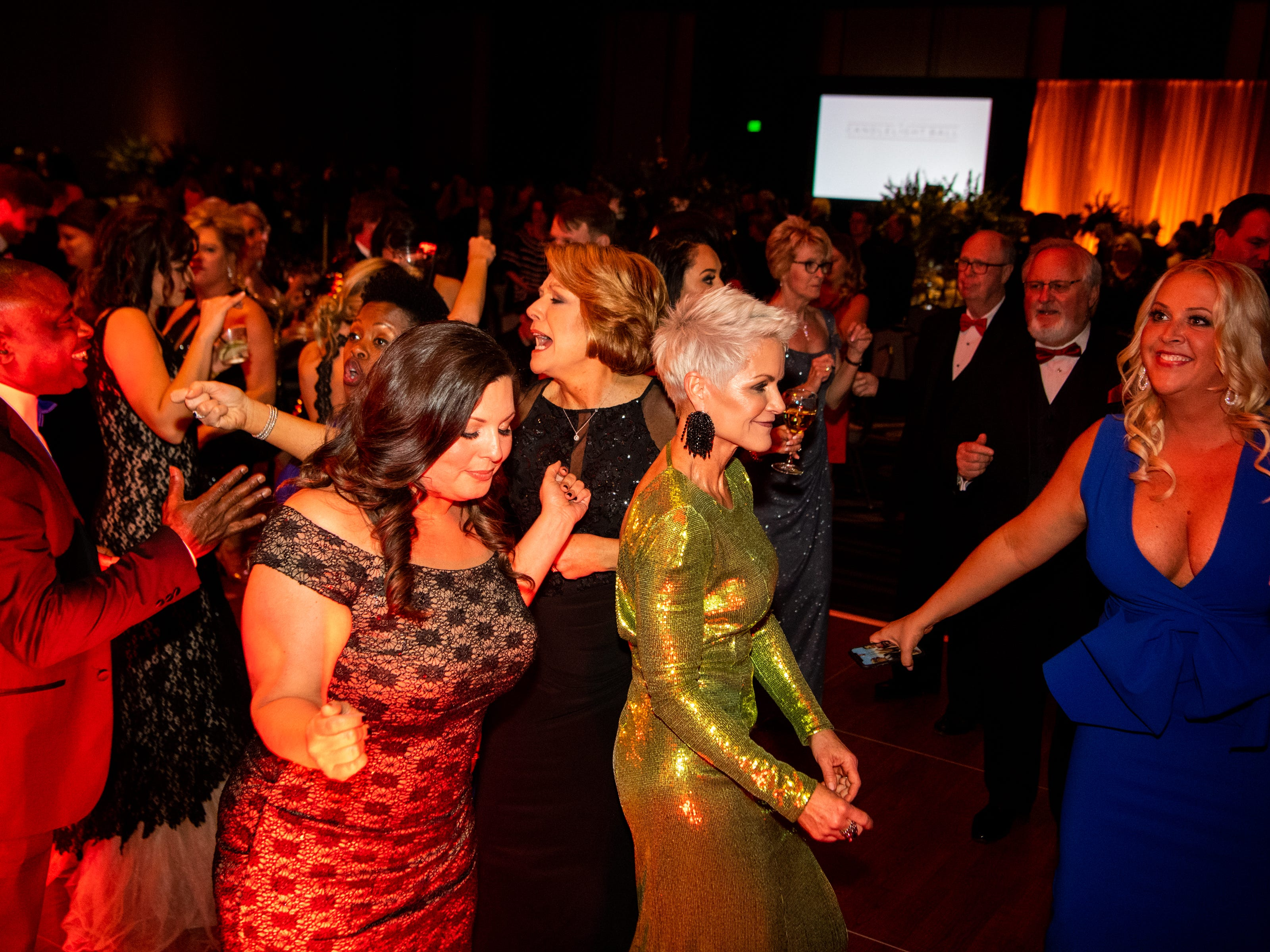 People begin to dance during Austin Peay State University's annual Candlelight Ball at the Omni Nashville Hotel Saturday, March 16, 2019, in Nashville, Tenn.
