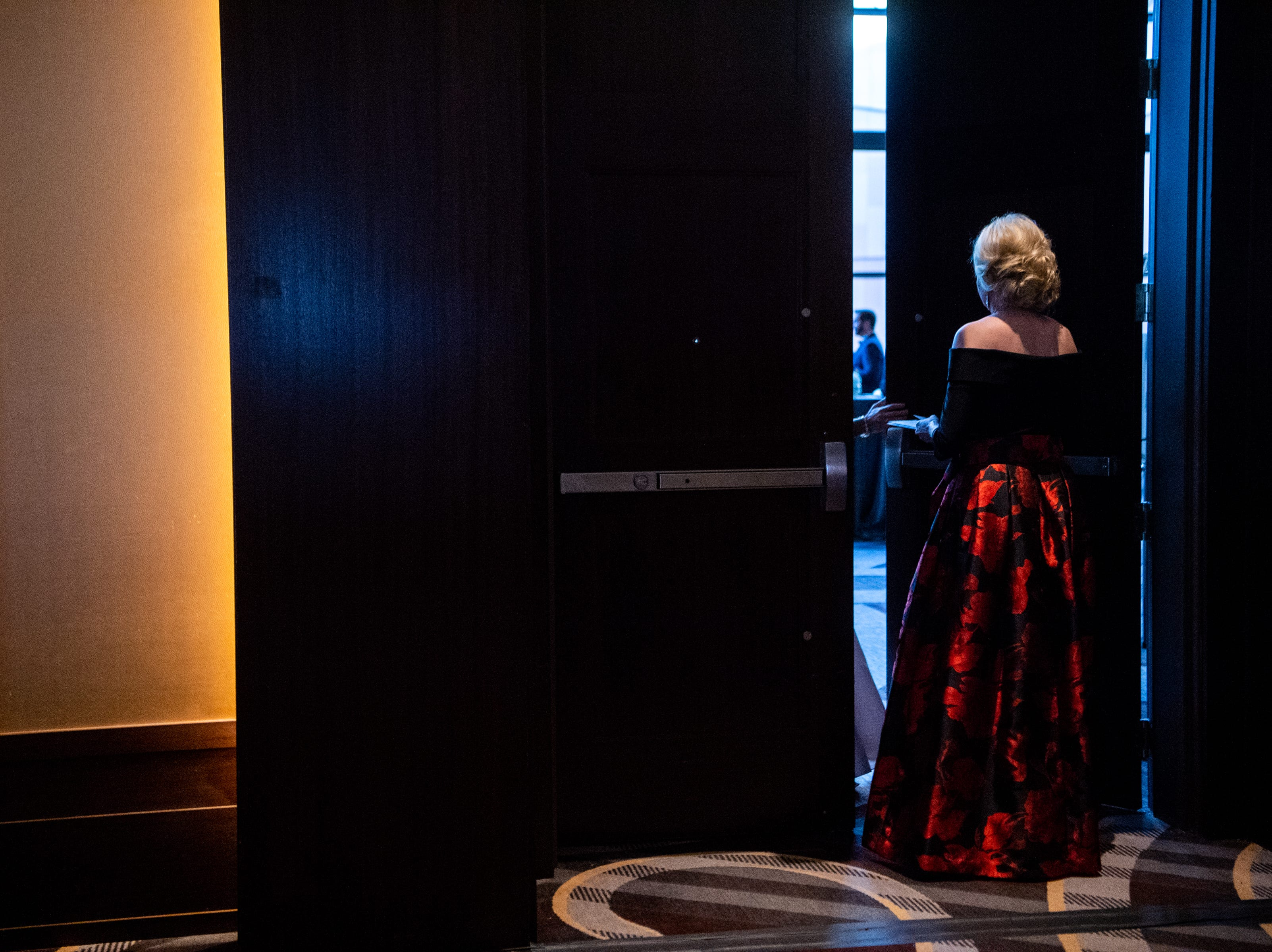 Co-chair Andrea Herrera exits the hall before the Austin Peay State University's annual Candlelight Ball at the Omni Nashville Hotel Saturday, March 16, 2019, in Nashville, Tenn.