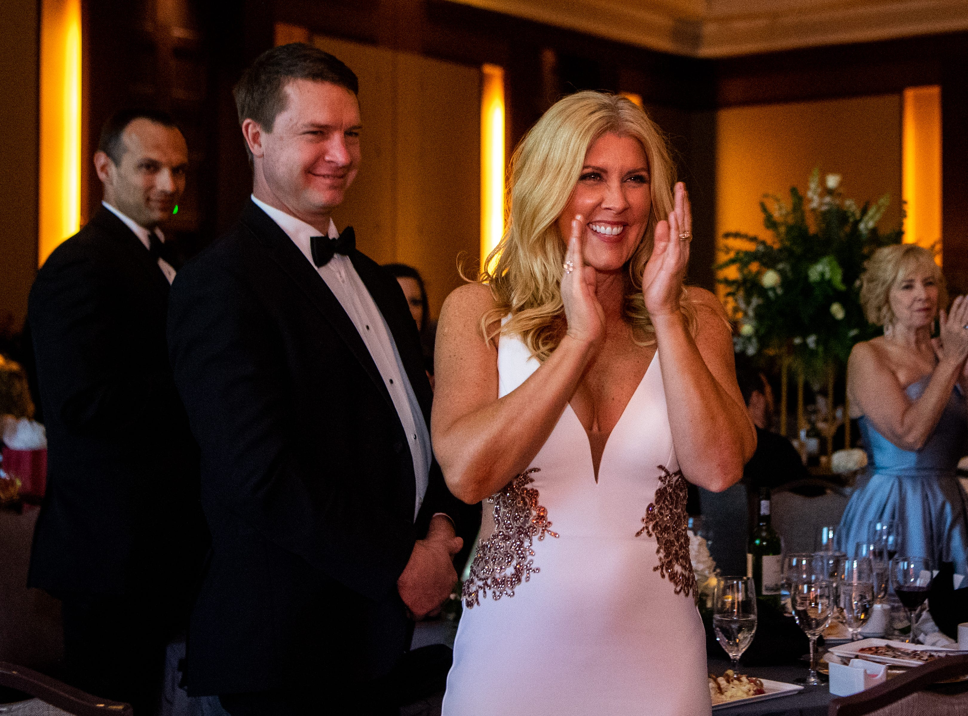People applaud for Dr. Jeannie Beauchamp after being given the Wendell H. Gilbert Award during Austin Peay State University's annual Candlelight Ball at the Omni Nashville Hotel Saturday, March 16, 2019, in Nashville, Tenn.