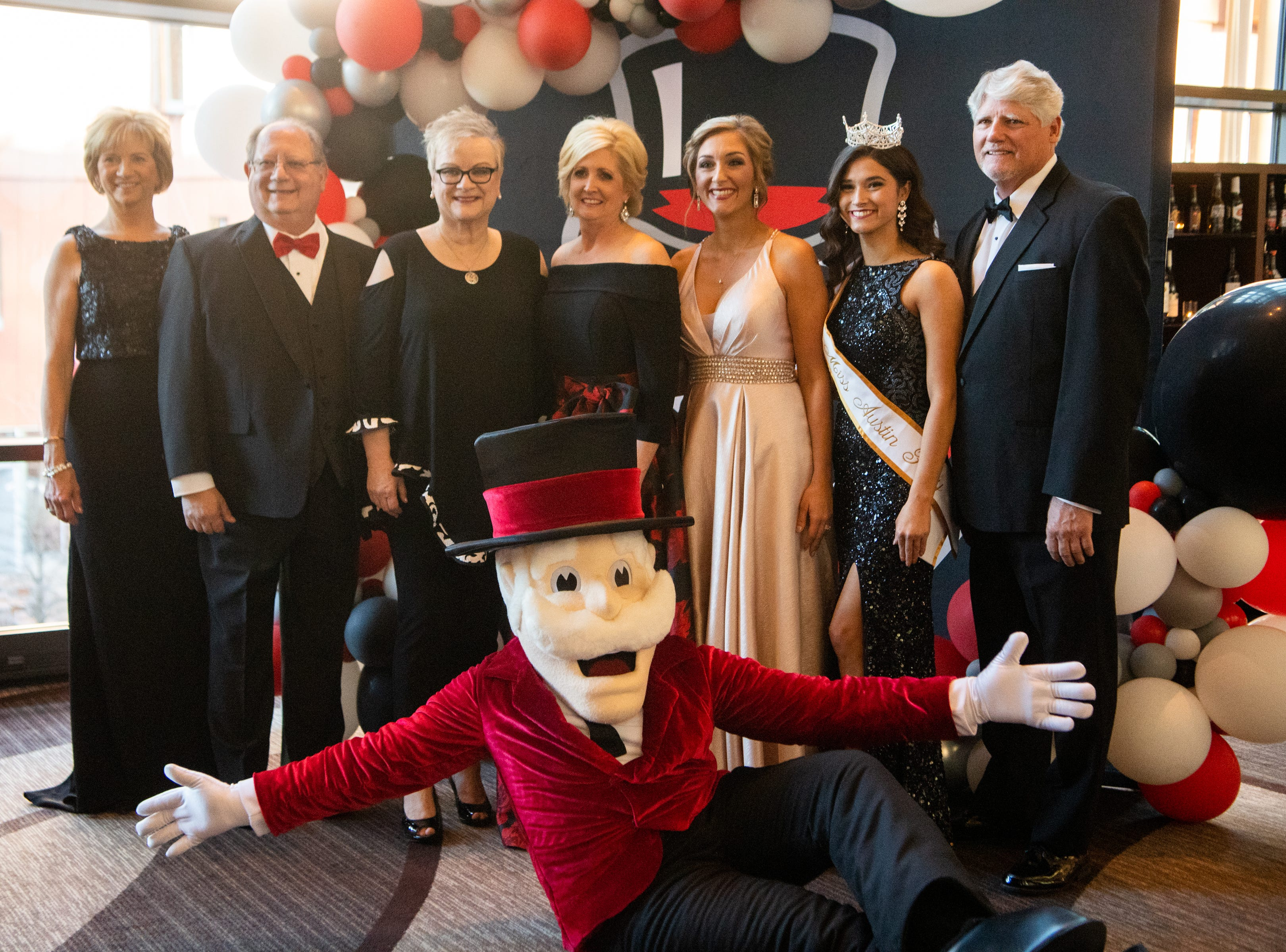 Dr. Jeannie Beauchamp, Elliott Herzlich, Dr. Alisa White, Andrea Herrera, Kathryn Minniehan, Allie Privitt and Len Rye (from left) pose for a photo during Austin Peay State University's annual Candlelight Ball at the Omni Nashville Hotel Saturday, March 16, 2019, in Nashville, Tenn.