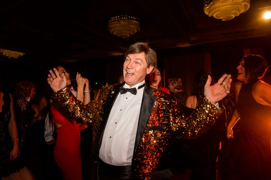 Kevin Kennedy shows off his sequin jacket and dance moves during Austin Peay State University's annual Candlelight Ball at the Omni Nashville Hotel Saturday, March 16, 2019, in Nashville, Tenn.