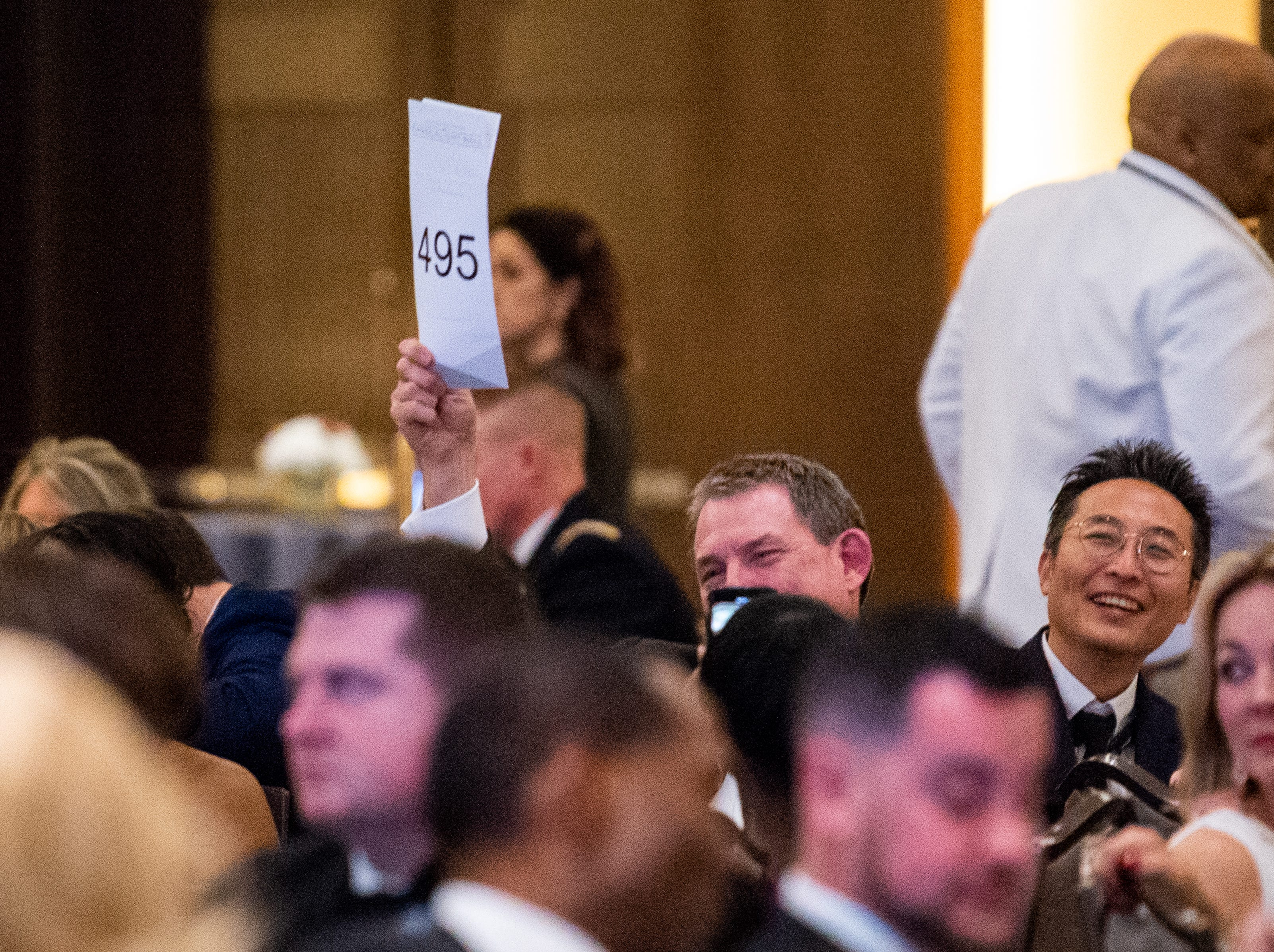 People bid on items to help raise money during Austin Peay State University's annual Candlelight Ball at the Omni Nashville Hotel Saturday, March 16, 2019, in Nashville, Tenn.