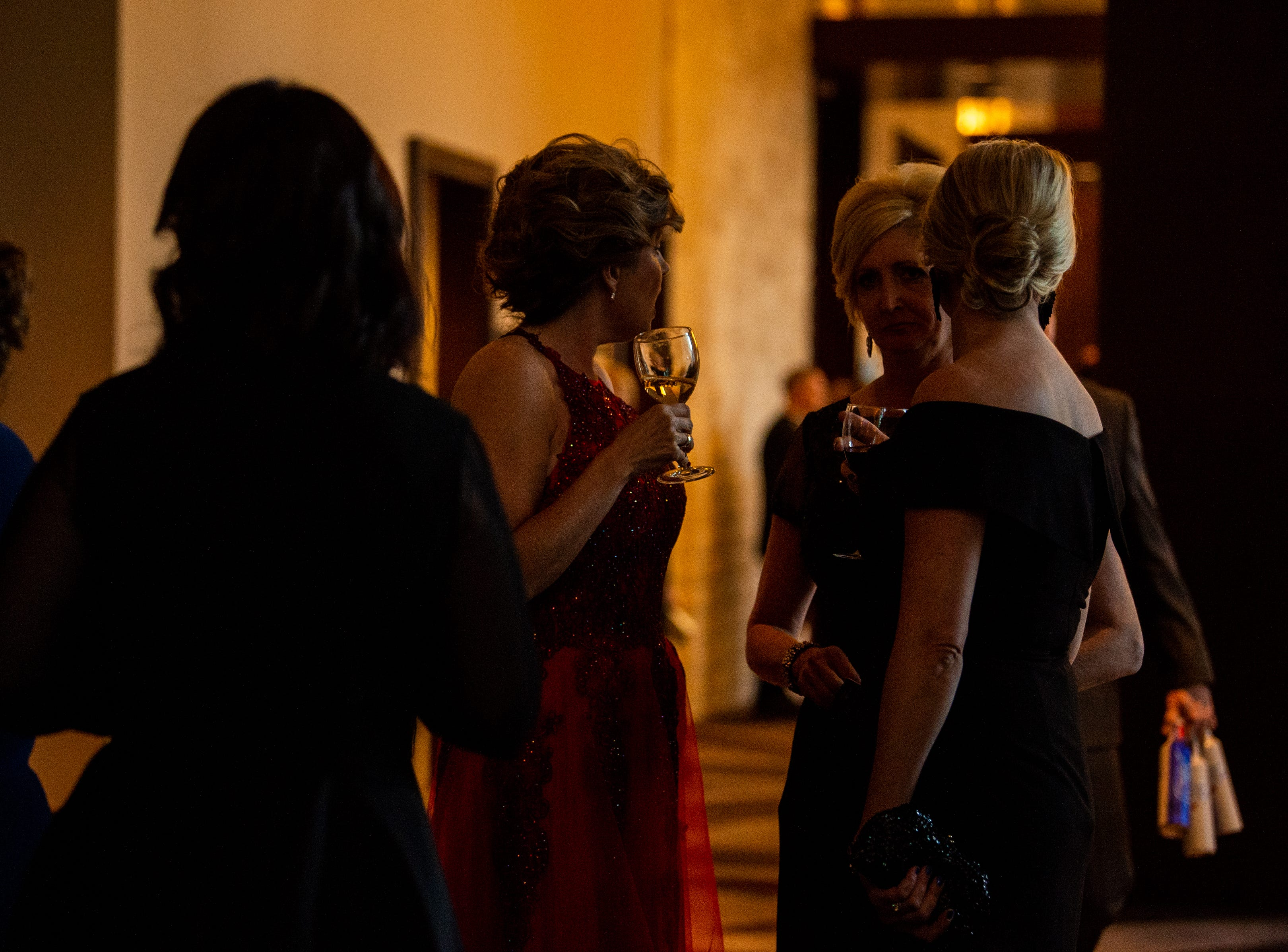 People gather for drinks before they enter the hall during Austin Peay State University's annual Candlelight Ball at the Omni Nashville Hotel Saturday, March 16, 2019, in Nashville, Tenn.