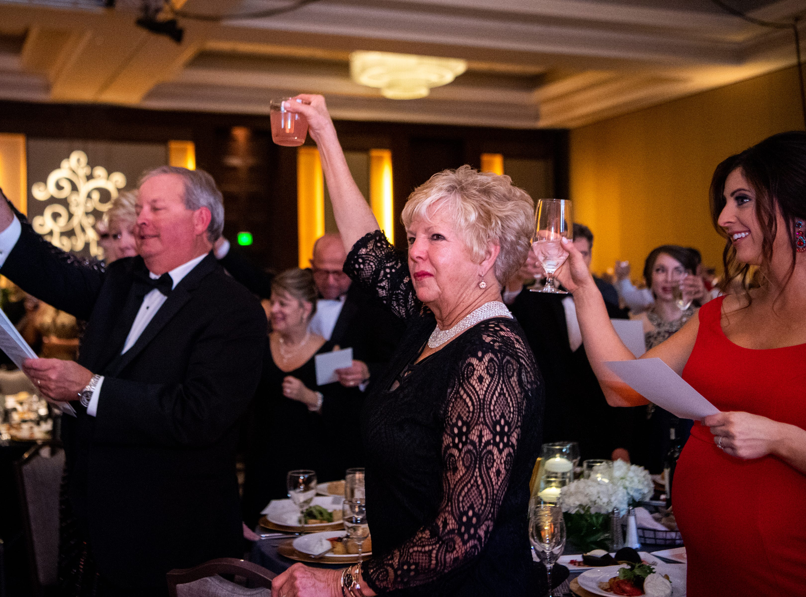 Attendees raise their glasses during Austin Peay State University's annual Candlelight Ball at the Omni Nashville Hotel Saturday, March 16, 2019, in Nashville, Tenn.