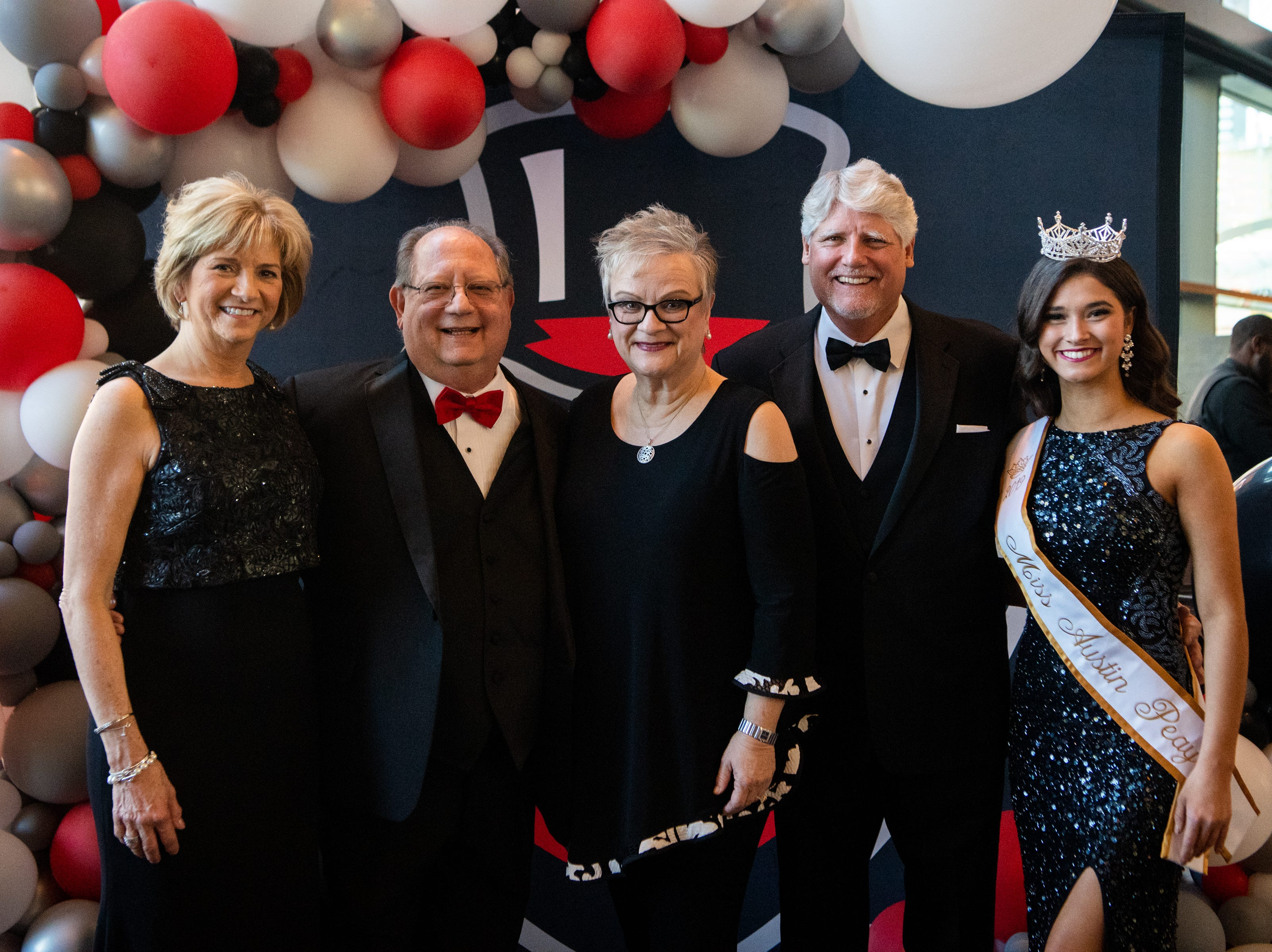 Dr. Jeannie Beauchamp, Elliott Herzlich, Dr. Alisa White, Len Rye and Allie Privitt (from left) pose for a photo during Austin Peay State University's annual Candlelight Ball at the Omni Nashville Hotel Saturday, March 16, 2019, in Nashville, Tenn.