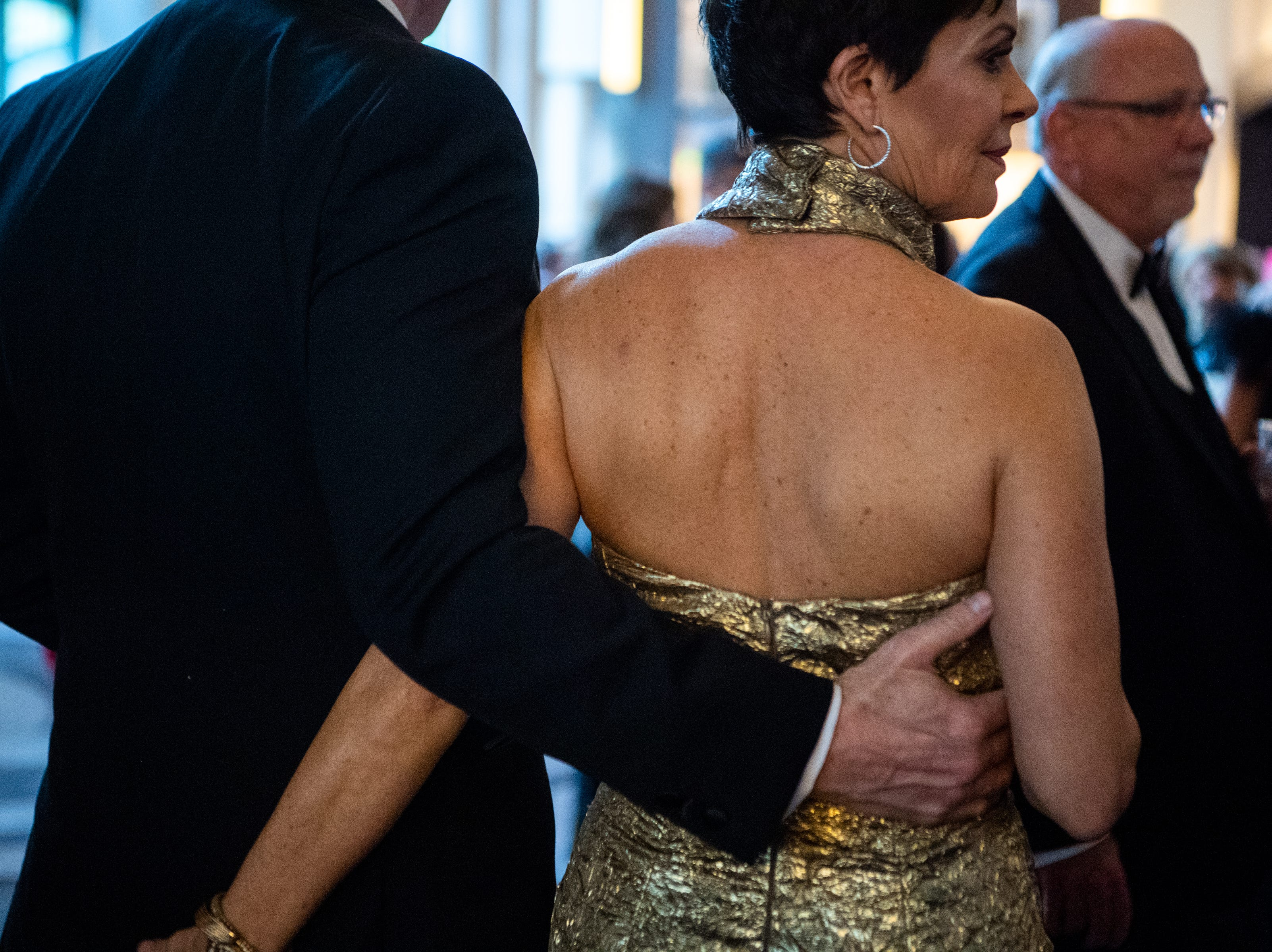 People walk arm and arm to Austin Peay State University's annual Candlelight Ball at the Omni Nashville Hotel Saturday, March 16, 2019, in Nashville, Tenn.