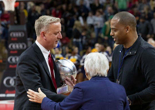 Saddle River Day coach Danny Brown (left) accepts the runner-up trophy. Franklin girls basketball vs Saddle River Day in 2019 NJSIAA Tournament of Champions final in Piscataway, N.J. on March 17, 2019.