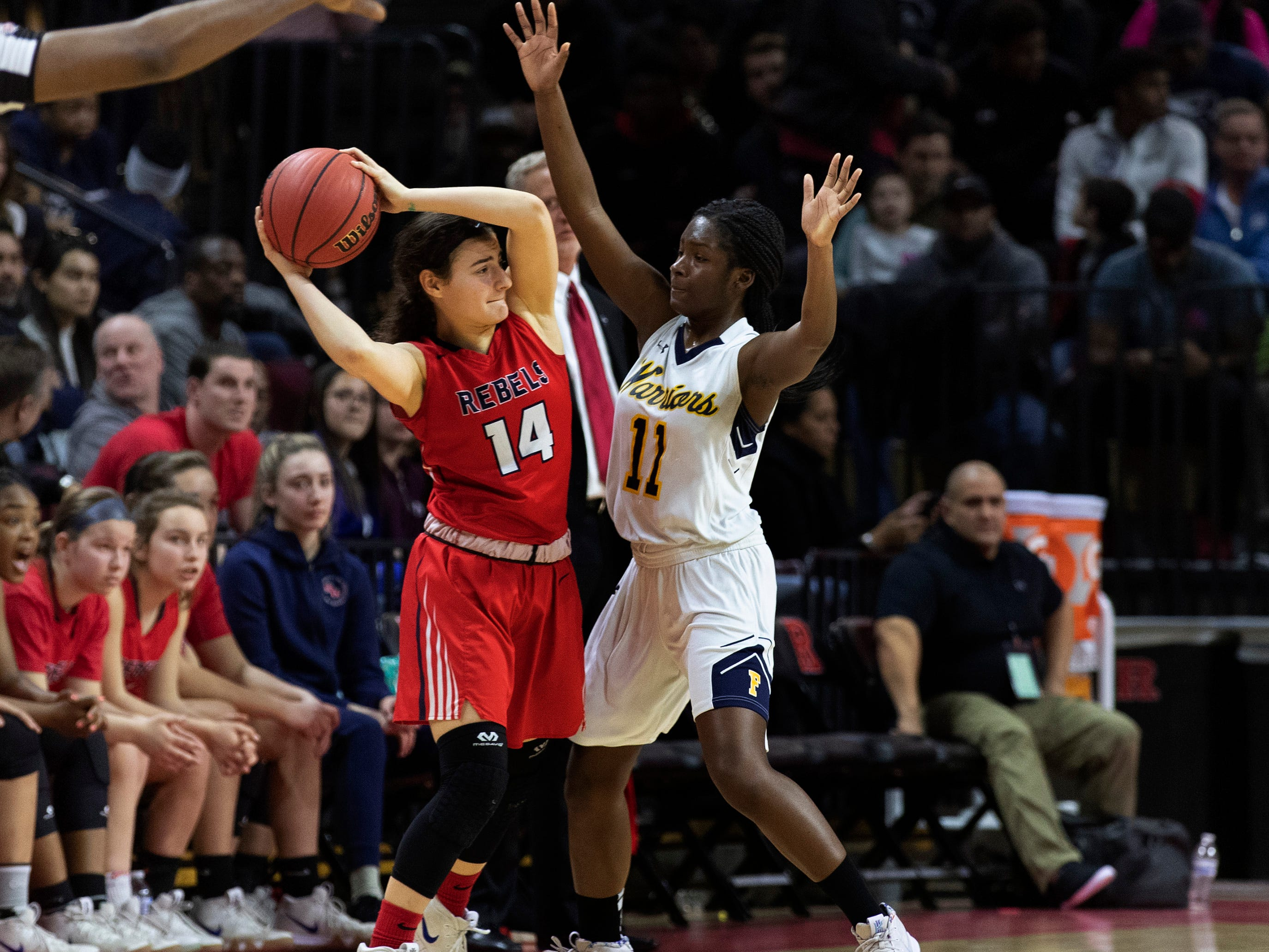 Saddle River Day's Jordan Janowski (14) is guarded by Franklin's Kennady Schenck. 2019 NJSIAA girls basketball Tournament of Champions final in Piscataway, N.J. on March 17, 2019.