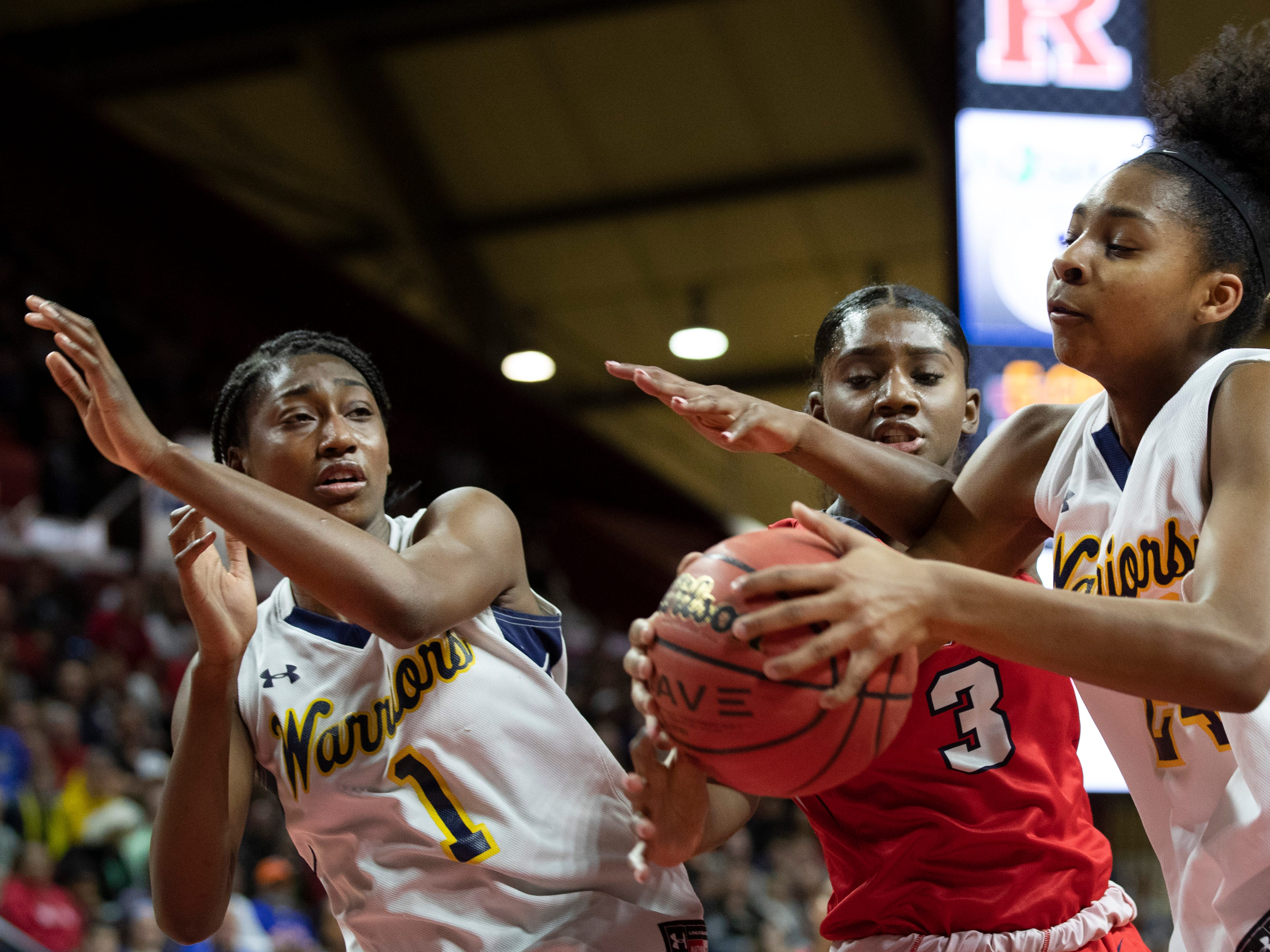 Saddle River Day's Jaida Patrick (3) and Franklin's Christina Midgette (24) battle for a rebound. Franklin vs Saddle River Day in 2019 NJSIAA girls basketball Tournament of Champions final in Piscataway, N.J. on March 17, 2019.
