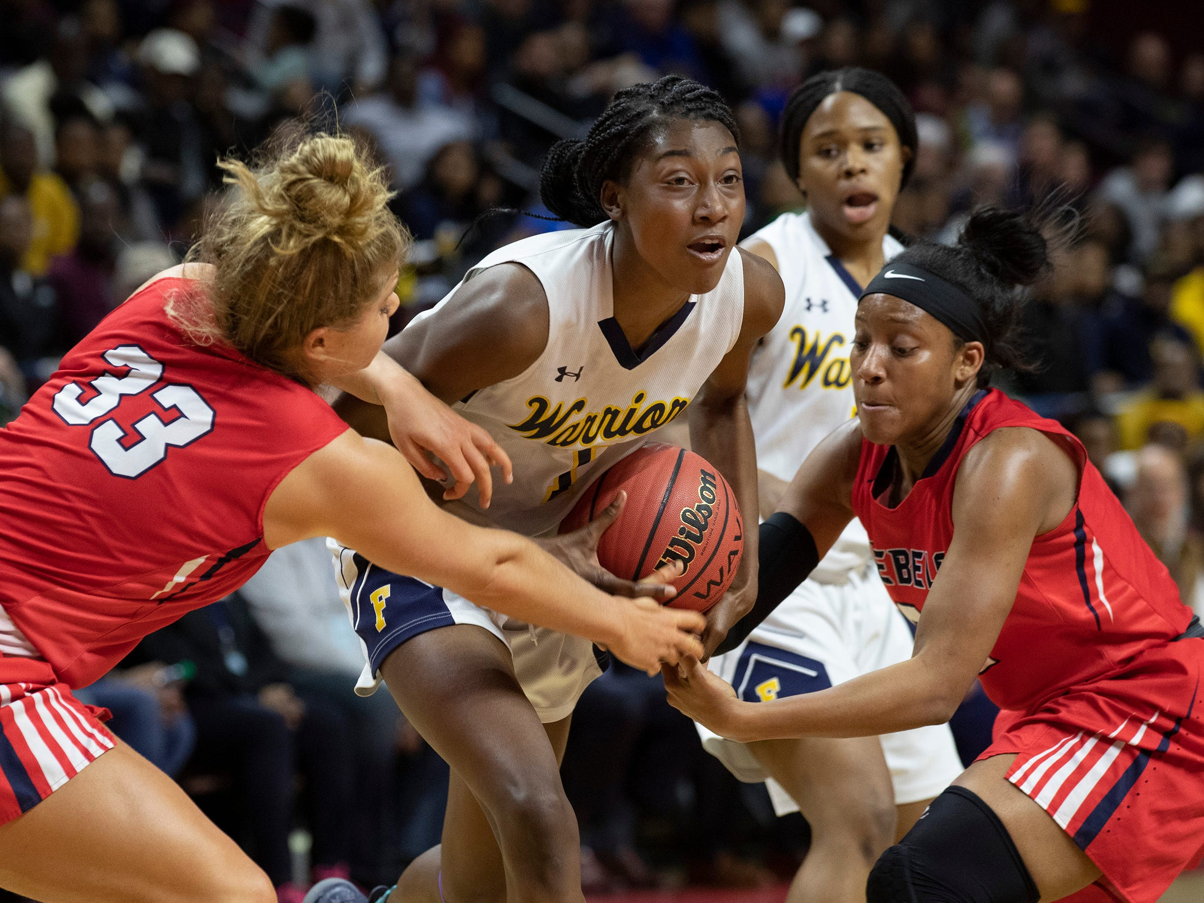 Franklin's Diamond Miller (1) tries to secure the ball from Saddle River Day defenders Jenna Jordan (33) and Sydnei Caldwell. 2019 NJSIAA girls basketball Tournament of Champions final in Piscataway, N.J. on March 17, 2019.