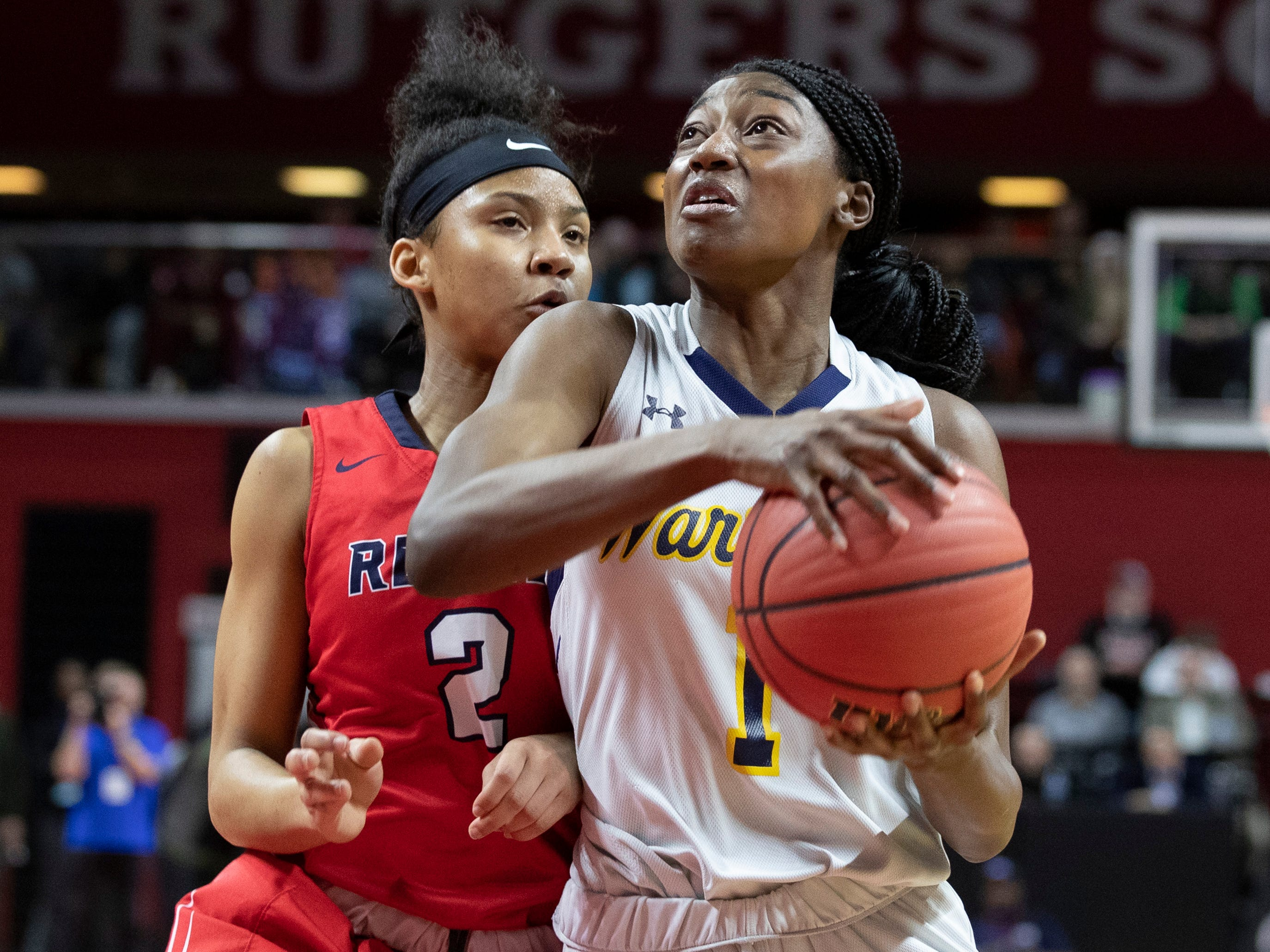 Saddle River Day's Saniah Caldwell (2) tries to stop Franklin's Diamond Miller from scoring. 2019 NJSIAA girls basketball Tournament of Champions in Piscataway, N.J. on March 17, 2019.