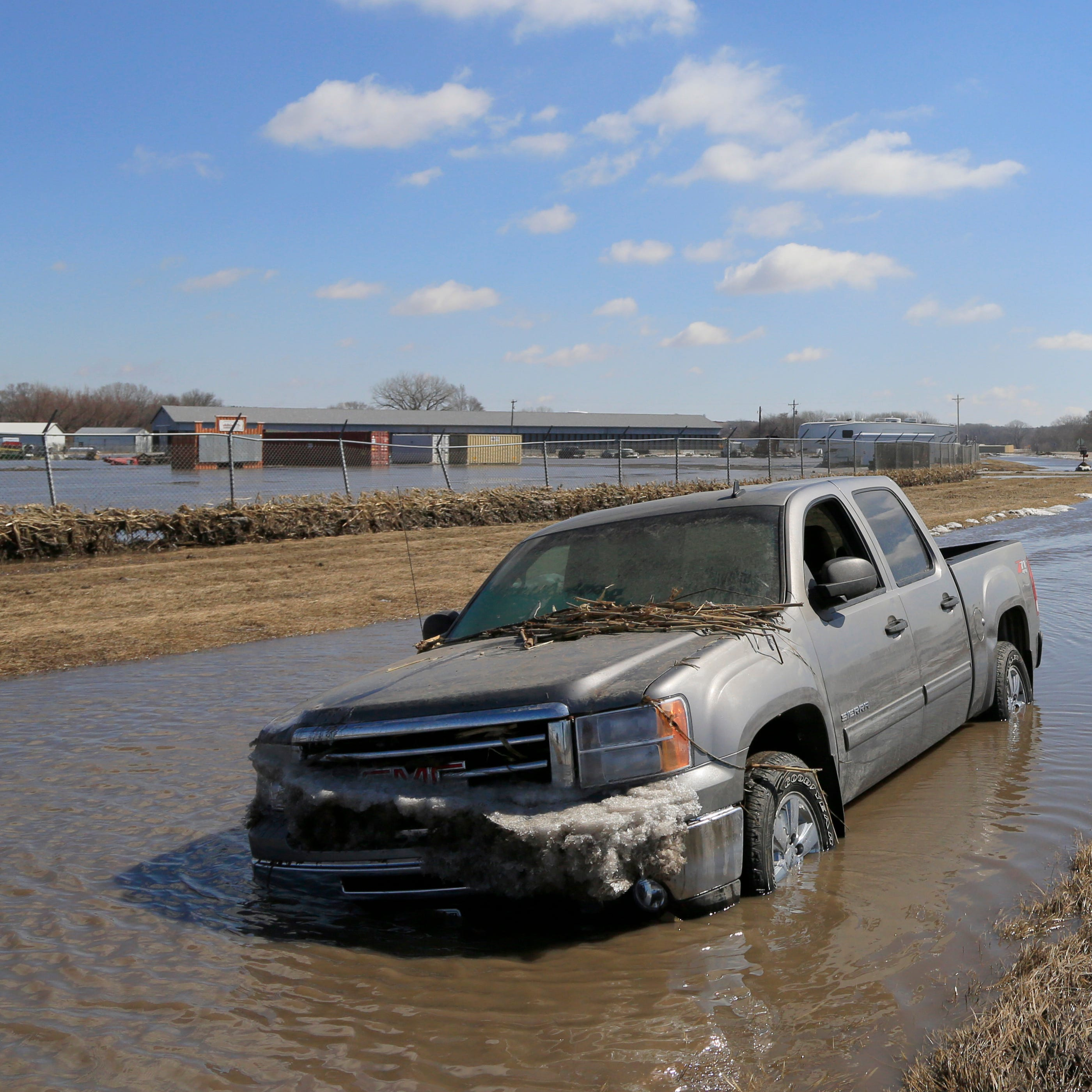 Western Iowa farmers rush to save grain, livestock before Missouri flood waters overtake them