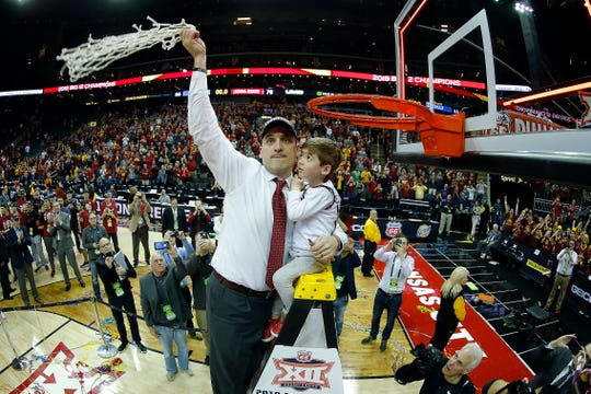KANSAS CITY, MISSOURI - MARCH 16:  Head coach Steve Prohm and son Cass (4) of the Iowa State Cyclones cut and wave the net after the Cyclones defeated the Kansas Jayhawks 78-66 to win the Big 12 Basketball Tournament Finals at Sprint Center on March 16, 2019 in Kansas City, Missouri. (Photo by Jamie Squire/Getty Images)