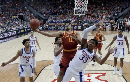 Iowa State's Talen Horton-Tucker (11) shoots next to Kansas' David McCormack (33) during the first half of an NCAA college basketball game in the Big 12 men's tournament final Saturday, March 16, 2019, in Kansas City, Mo. (AP Photo/Charlie Riedel)