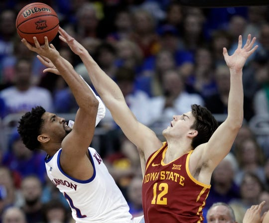 Kansas forward Dedric Lawson (1) is fouled by Iowa State forward Michael Jacobson (12) during the second half of an NCAA college basketball game in the finals of the Big 12 men's tournament in Kansas City, Mo., Saturday, March 16, 2019. (AP Photo/Orlin Wagner)