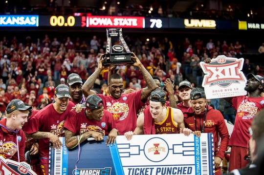 Mar 16, 2019; Kansas City, MO, USA; The Iowa State Cyclones celebrate after defeating the Kansas Jayhawks in the final of the Big 12 conference tournament at Sprint Center. Mandatory Credit: Amy Kontras-USA TODAY Sports