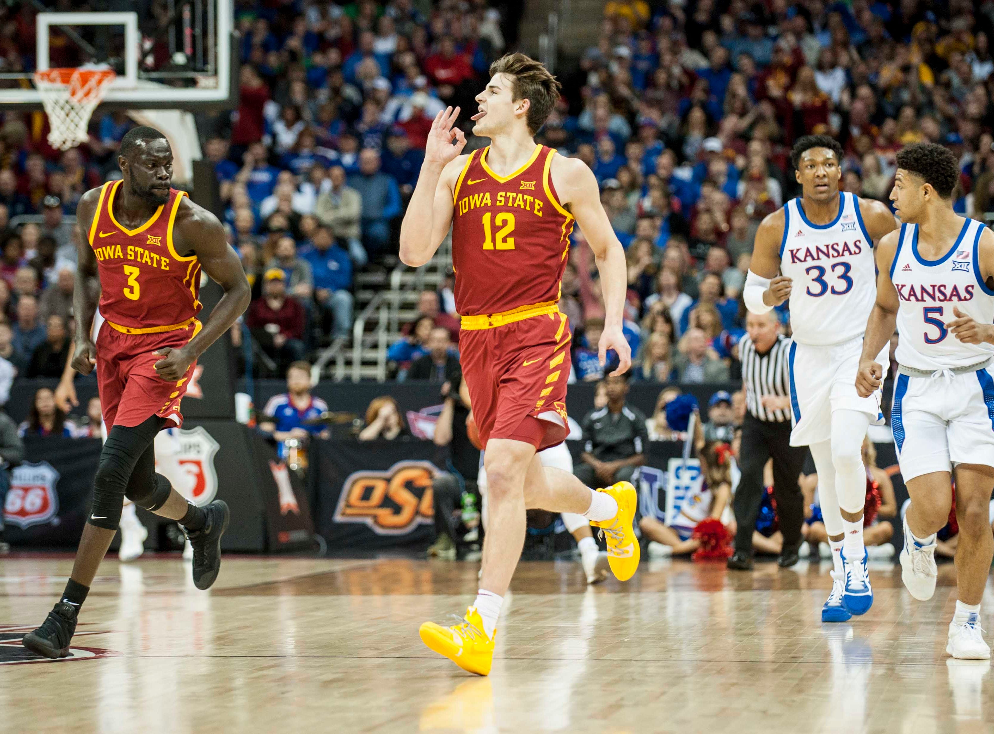 Mar 16, 2019; Kansas City, MO, USA; Iowa State Cyclones forward Michael Jacobson (12) celebrates after making a three-point shot against the Kansas Jayhawks during the first half of the final of the Big 12 conference tournament at Sprint Center.