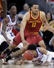 Iowa State guard Talen Horton-Tucker (11) moves around fallen Kansas guard Quentin Grimes (5) during the first half of an NCAA college basketball game in the final of the Big 12 men's tournament in Kansas City, Mo., Saturday, March 16, 2019. (AP Photo/Orlin Wagner)