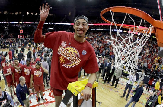 Iowa State's Tyrese Haliburton holds up a piece of the net after Iowa State defeated Kansas 78-66 in an NCAA college basketball game to win the Big 12 men's tournament Saturday, March 16, 2019, in Kansas City, Mo. (AP Photo/Charlie Riedel)