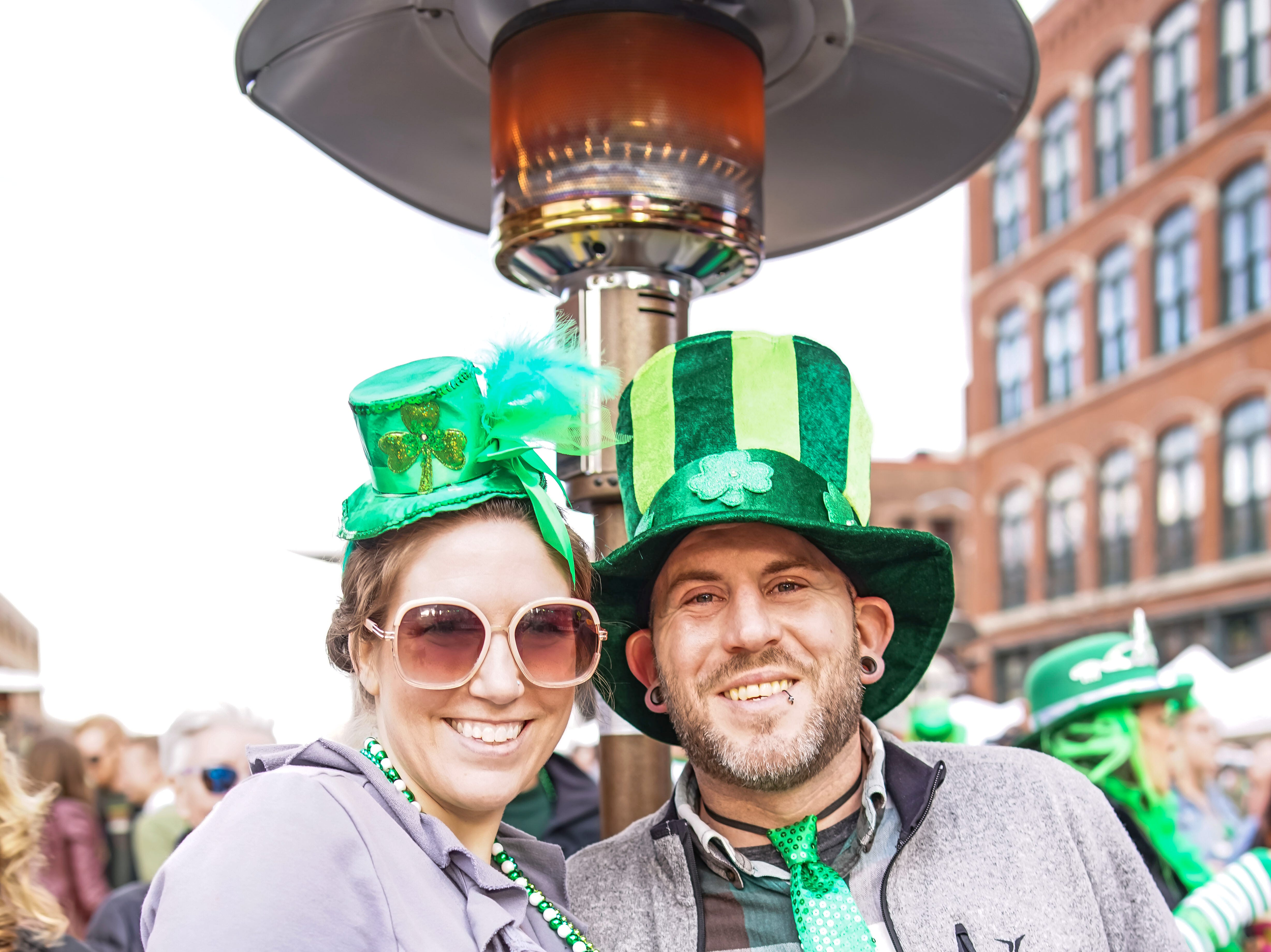 Victoria Oaks, 28, and Ryan Oaks, 36, both of Des Moines, having a fun time, Saturday, March 16, 2019, at the Court Avenue Block Party.