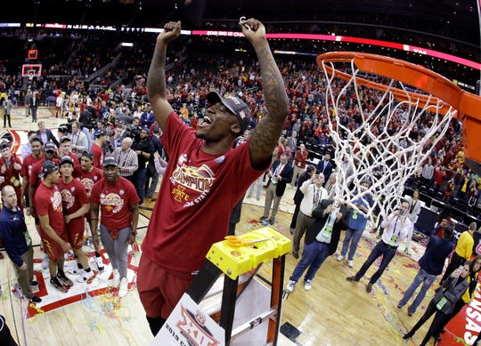 Iowa State's Cameron Lard holds up a piece of the net after Iowa State defeated Kansas 78-66 in an NCAA college basketball game to win the Big 12 men's tournament Saturday, March 16, 2019, in Kansas City, Mo. (AP Photo/Charlie Riedel)
