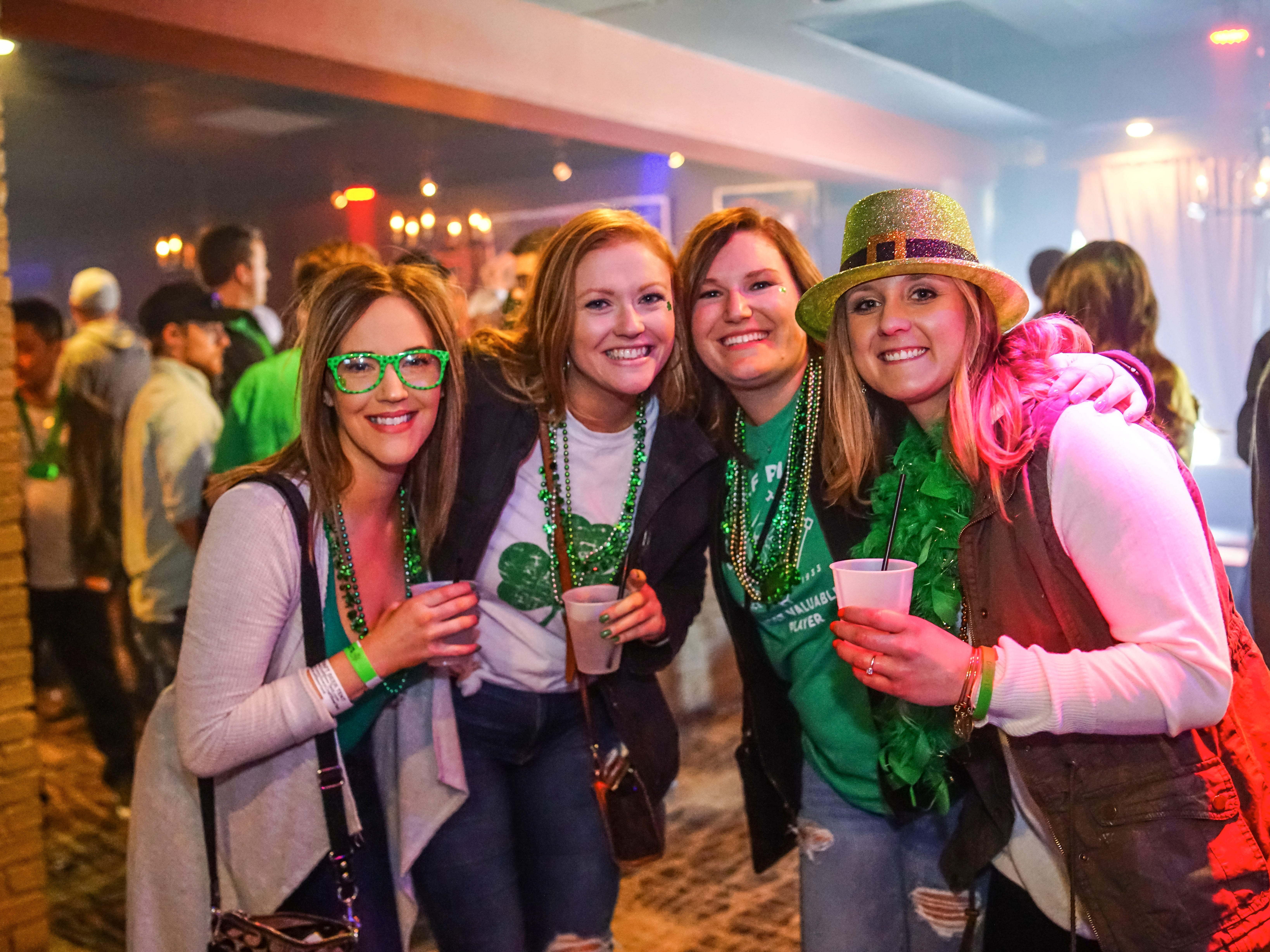Emily Moe, 23, Haley Brenneman, 24, Hannah Brenneman, 24, and Taylor Yirkovsky, 27, all of Des Moines, having a great time, Saturday, March 16, 2019, at Voodoo Lounge.