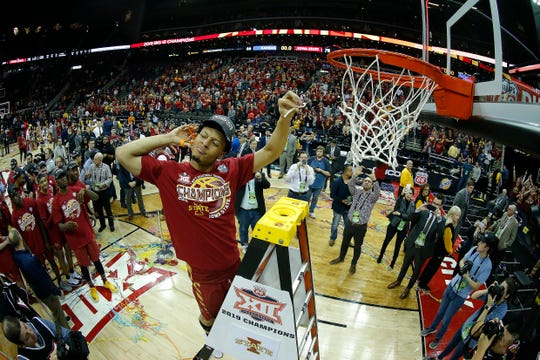 KANSAS CITY, MISSOURI - MARCH 16:  Lindell Wigginton #5 of the Iowa State Cyclones cuts a piece of the net after the Cyclones defeated the Kansas Jayhawks 78-66 to win the Big 12 Basketball Tournament Finals at Sprint Center on March 16, 2019 in Kansas City, Missouri. (Photo by Jamie Squire/Getty Images)