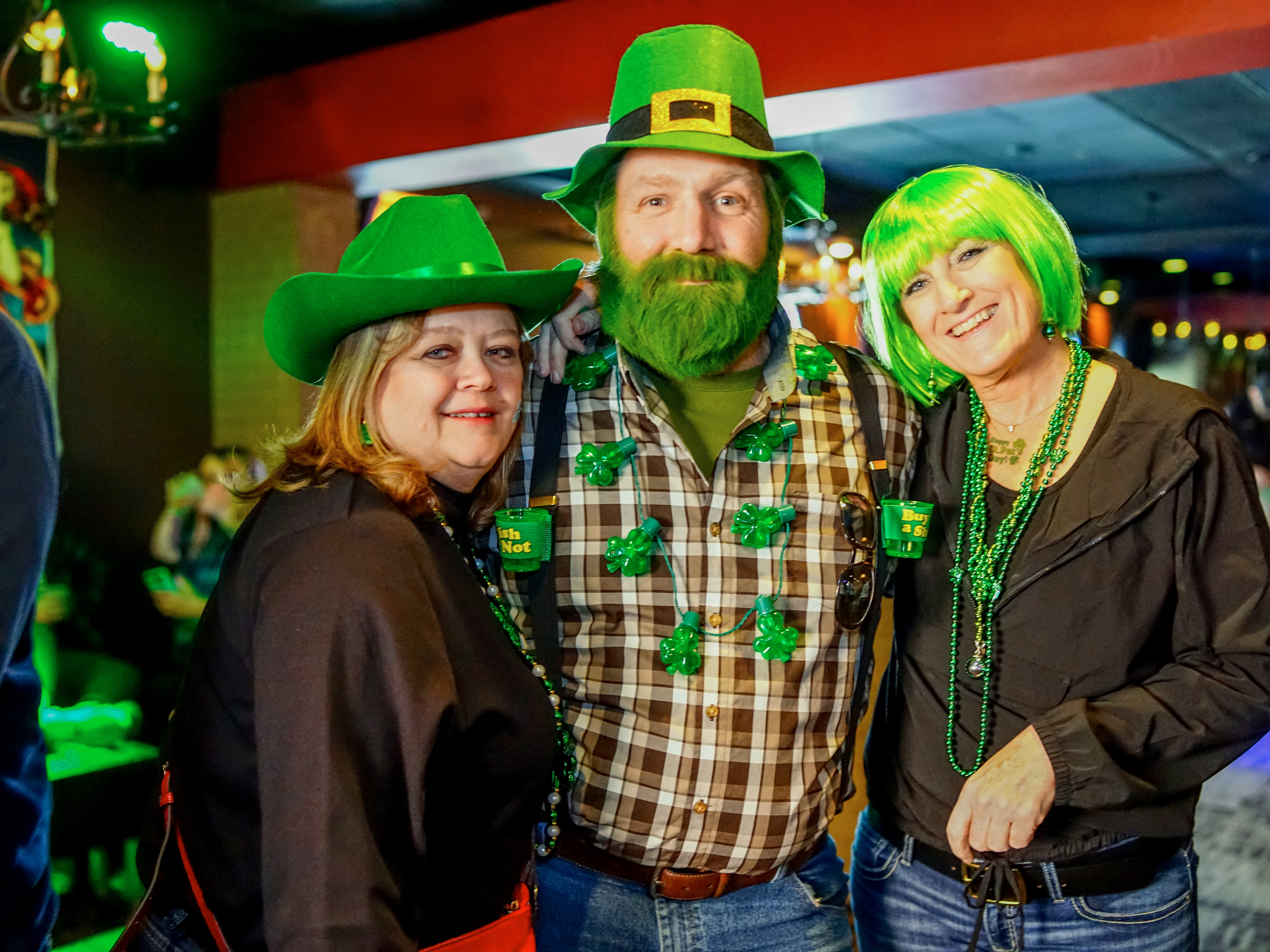 Stacy Stucki, 47, Jay Stucki, 41, and Diana Bershoof, 47, all of Des Moines, having a great time, Saturday, March 16, 2019, at Voodoo Lounge.