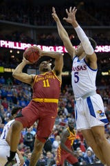 Iowa State's Talen Horton-Tucker puts up a shot around Kansas' Quentin Grimes during the championship game in the Big 12 conference tournament on March 16, 2019, at Sprint Center in Kansas City, Missouri.