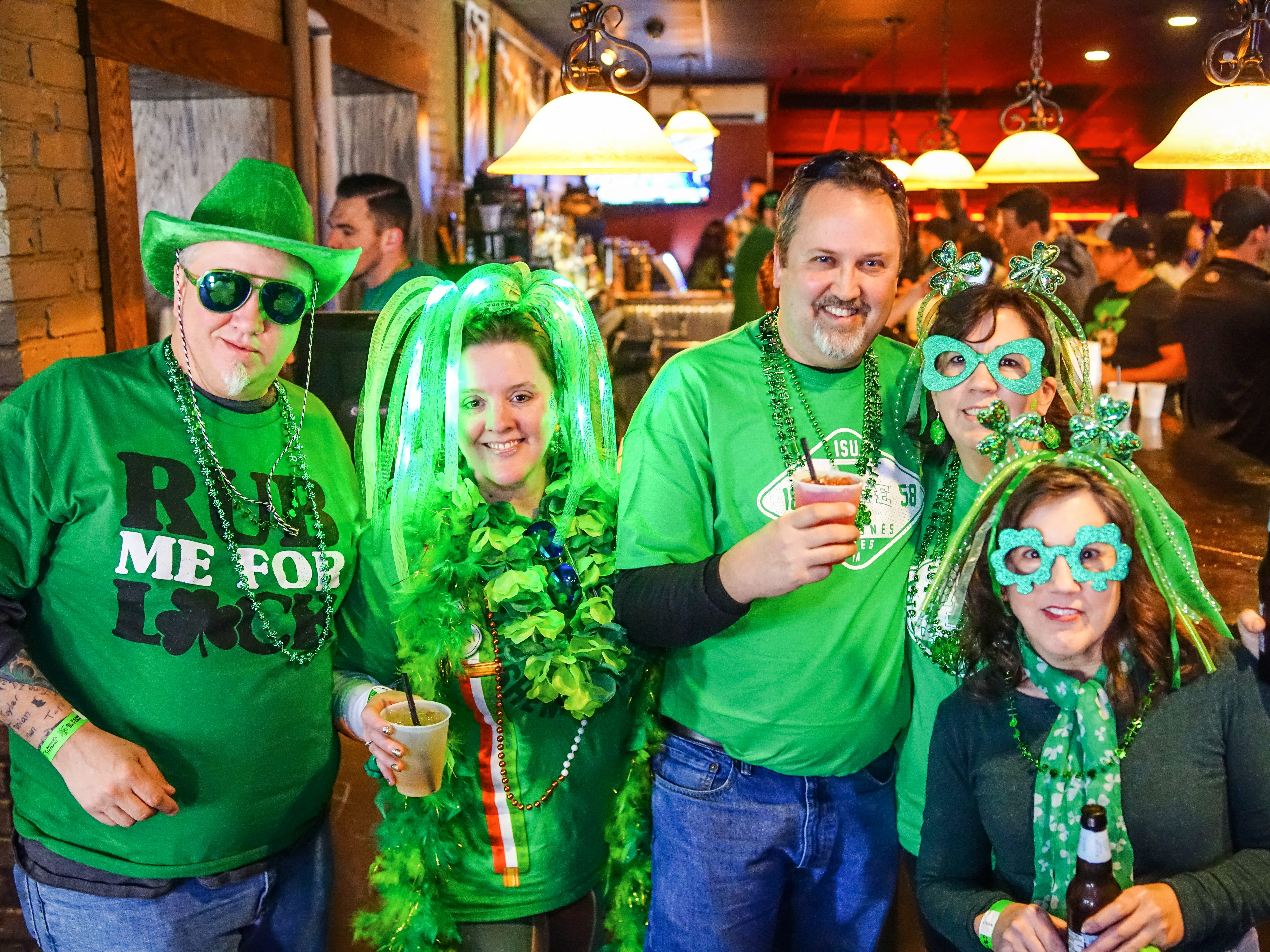 Sara Mertens, 42, Tyler Waddle, 38, Todd Waddle, 52, Kelly Waddle, 46, and Tonia Alexander, 42, all of Des Moines, having a fun time, Saturday, March 16, 2019, at Voodoo Lounge.