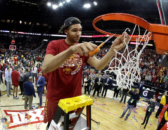 Iowa State's George Conditt IV cuts the net after Iowa State defeated Kansas 78-66 in an NCAA college basketball game to win the Big 12 men's tournament Saturday, March 16, 2019, in Kansas City, Mo. (AP Photo/Charlie Riedel)