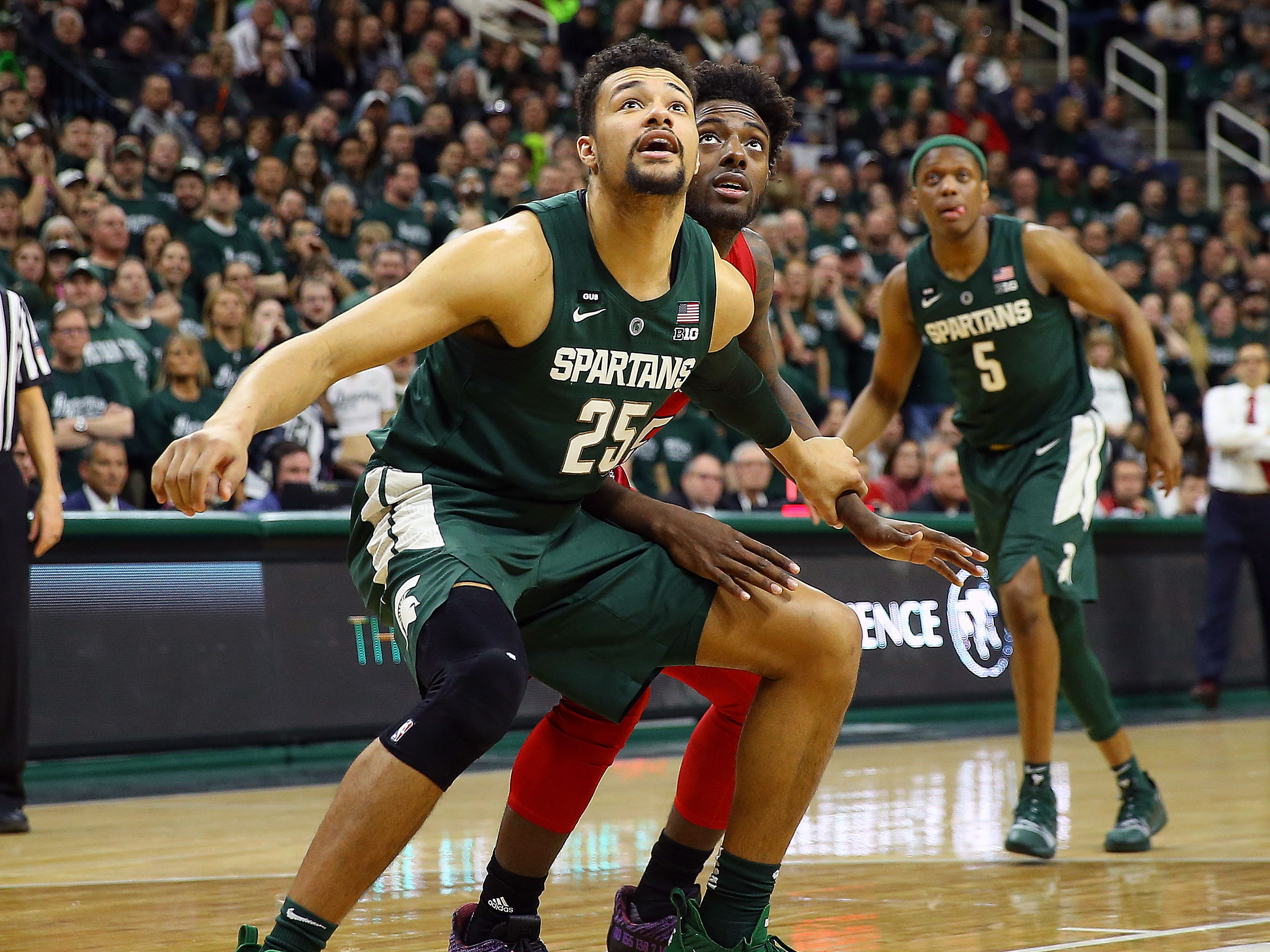 Michigan State Spartans forward Kenny Goins leads the team with 9 rebounds per game this season.