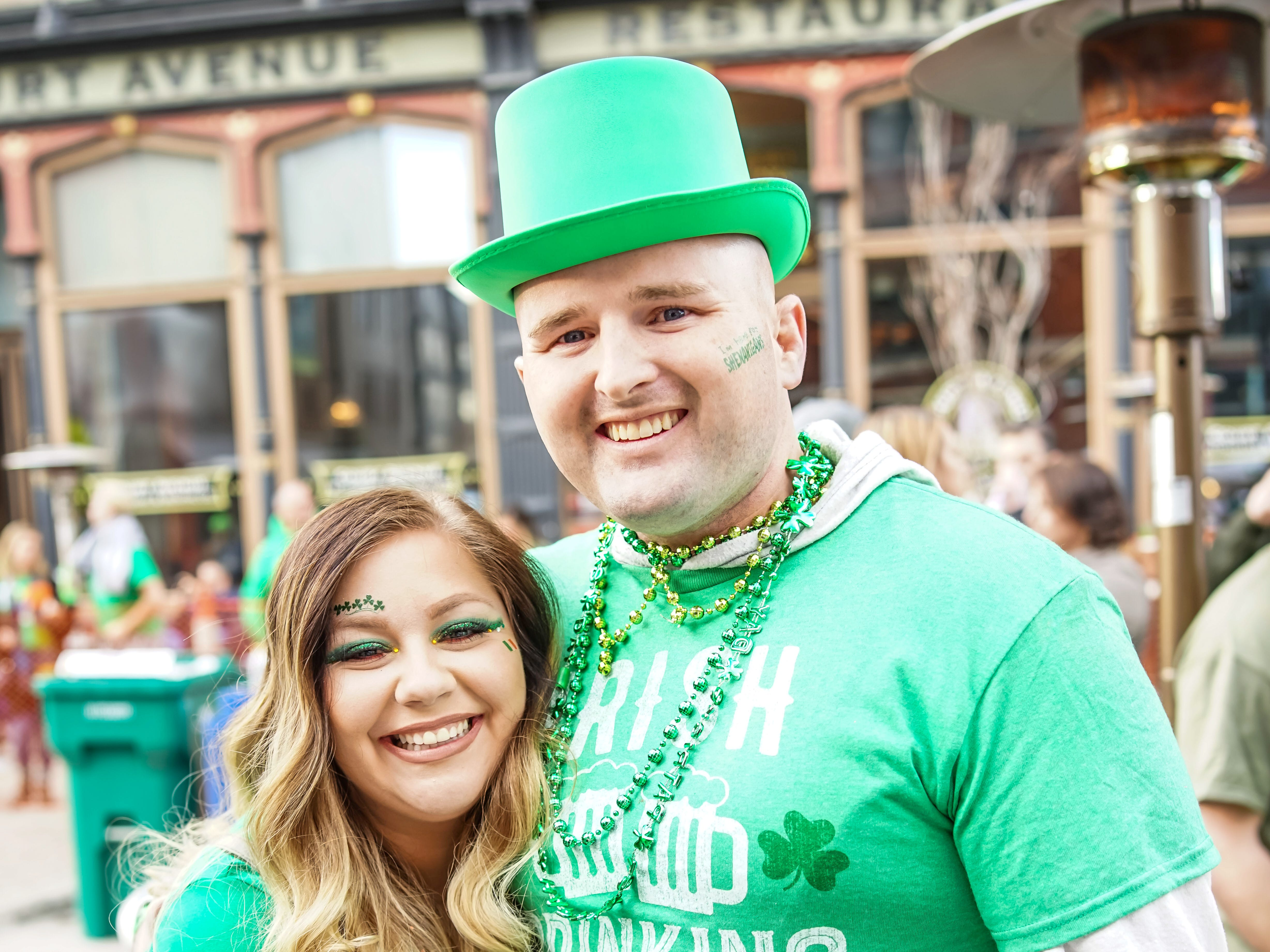 Chloe Miller, 28, and Andrew Miller, 31, both of Des Moines, enjoying their time, Saturday, March 16, 2019, at the Court Avenue Block Party.