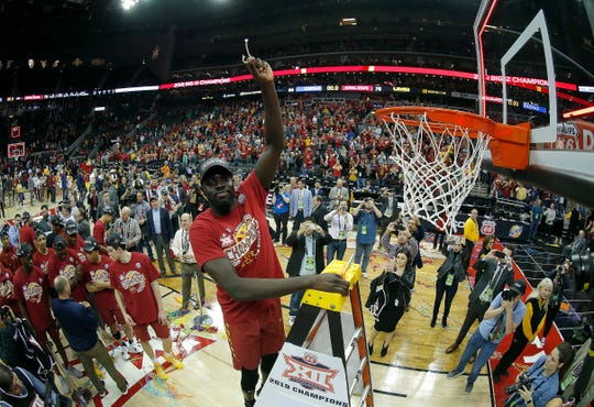 KANSAS CITY, MISSOURI - MARCH 16:  Marial Shayok #3 of the Iowa State Cyclones cuts a piece of the net after the Cyclones defeated the Kansas Jayhawks 78-66 to win the Big 12 Basketball Tournament Finals at Sprint Center on March 16, 2019 in Kansas City, Missouri. (Photo by Jamie Squire/Getty Images)