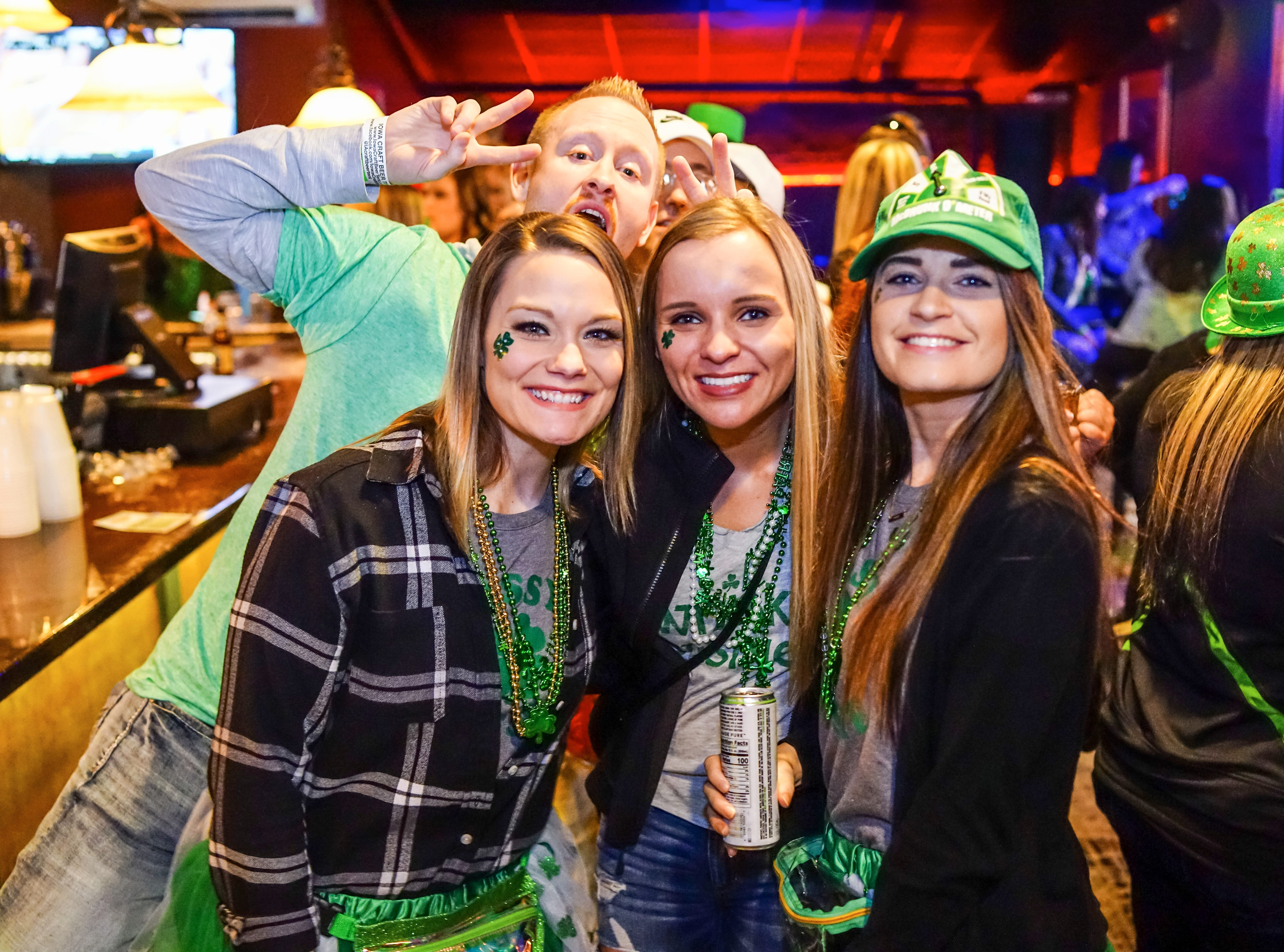 Chloe Barclay, 24, Kayla Steiter, 22, Jessica McGuire, 28, and Blake Frank, 31, all of Des Moines, having a great time, Saturday, March 16, 2019, at Voodoo Lounge.