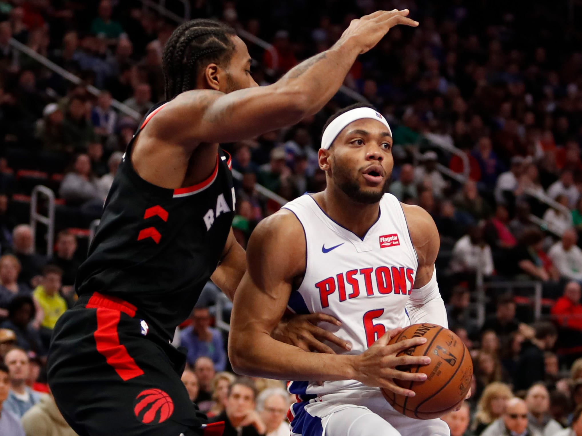 Detroit Pistons guard Bruce Brown is defended by Toronto Raptors forward Kawhi Leonard during the first quarter at Little Caesars Arena, Sunday, March 17, 2019.