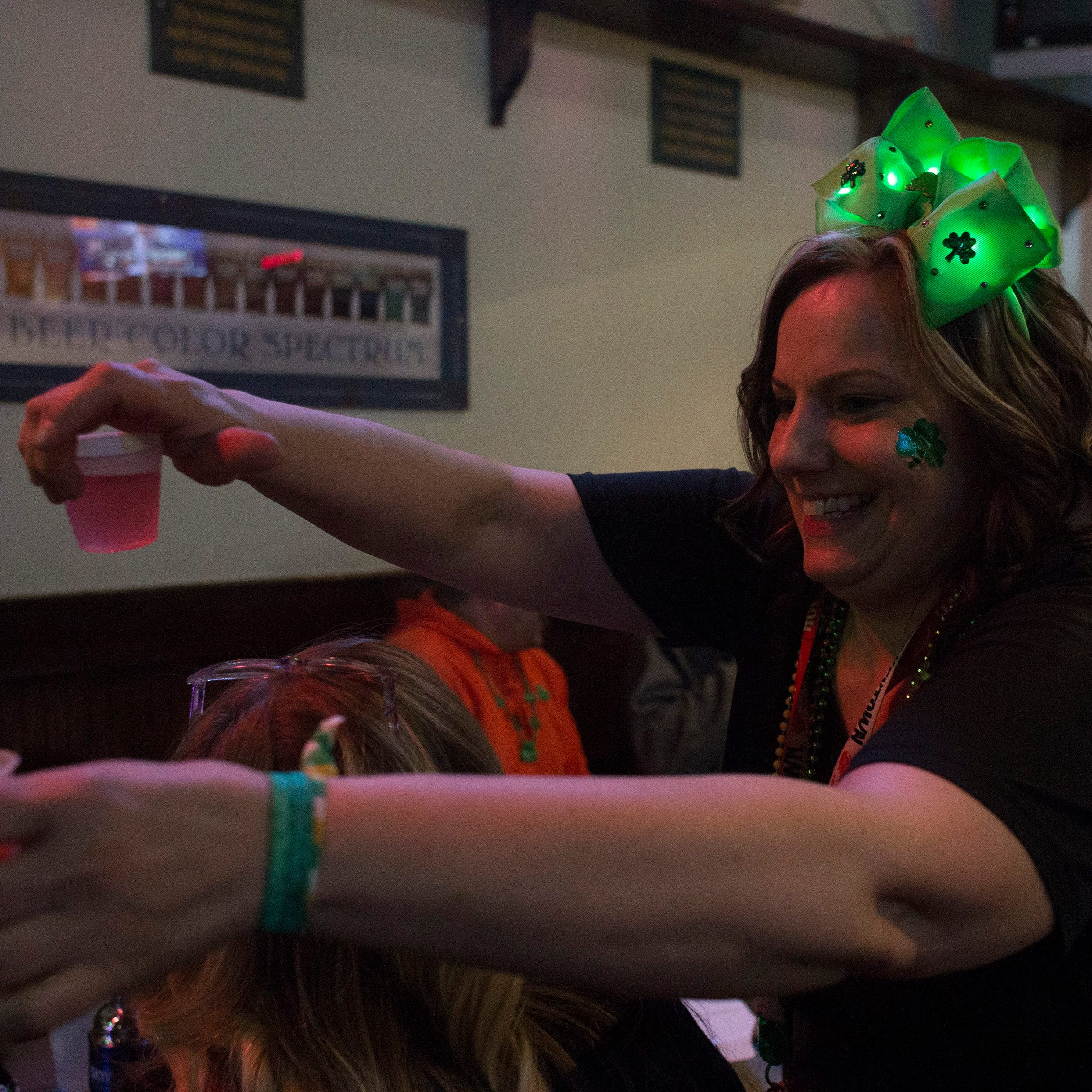 Green beer flows as Irish pub bids farewell on St. Patrick's Day
