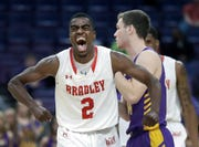 Bradley's Luqman Lundy (2) celebrates after making a basket as Northern Iowa's Spencer Haldeman, right, walks behind during the second half of an NCAA college basketball game in the championship of the Missouri Valley Conference tournament, Sunday, March 10, 2019, in St. Louis. Bradley won 57-54.