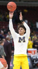 Jordan Poole warms up before the Big Ten tournament championship Sunday.