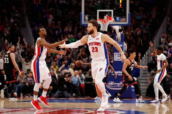 Blake Griffin (23) celebrates with Ish Smith during the fourth quarter of the Detroit Pistons' 110-107 win over the Toronto Raptors, Sunday, March 17, 2019, in Detroit.