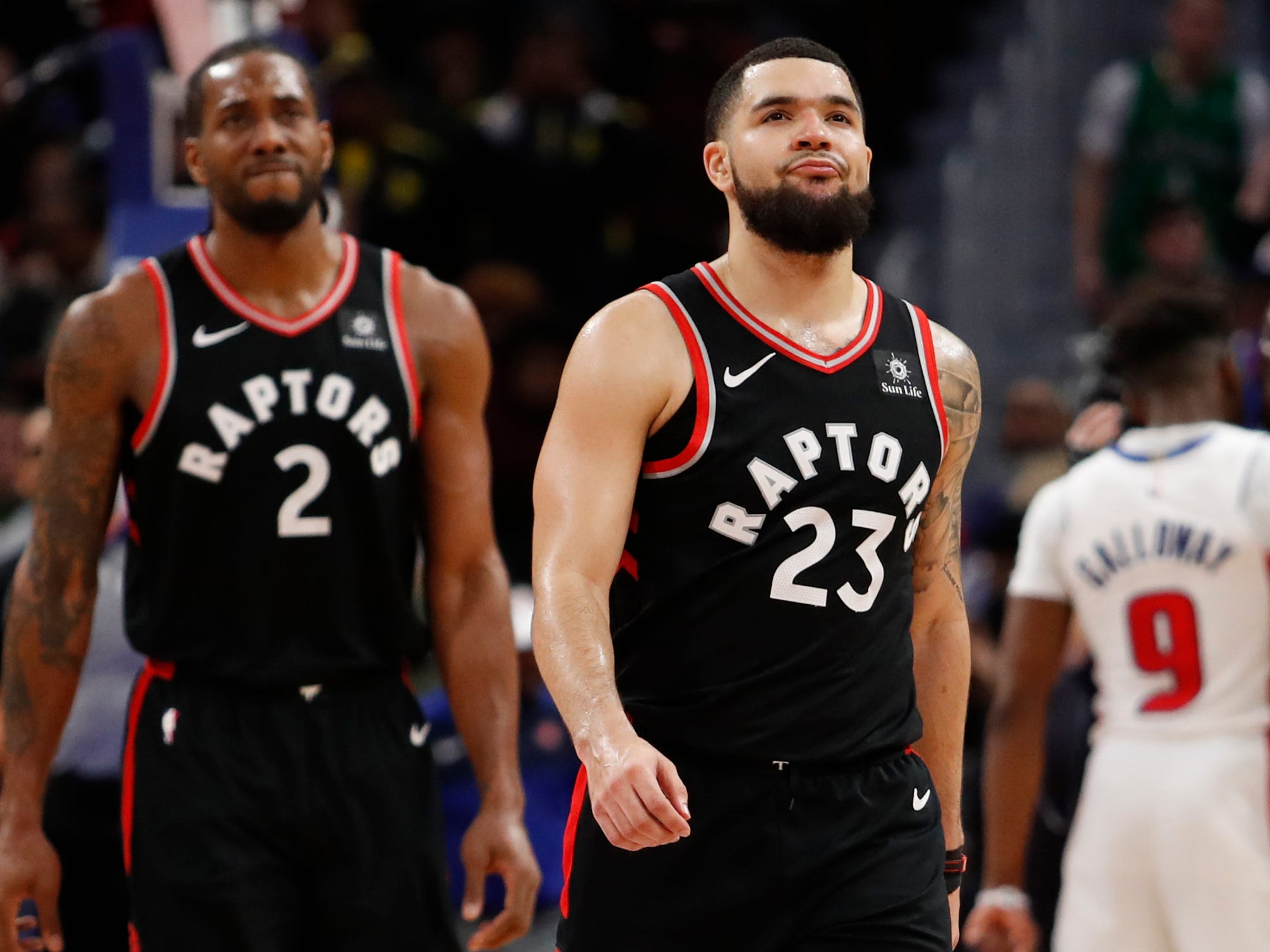 Toronto Raptors' Fred VanVleet (23) and Kawhi Leonard (2) walk to the bench during the fourth quarter of the Detroit Pistons' 110-107 win at Little Caesars Arena, Sunday, March 17, 2019.