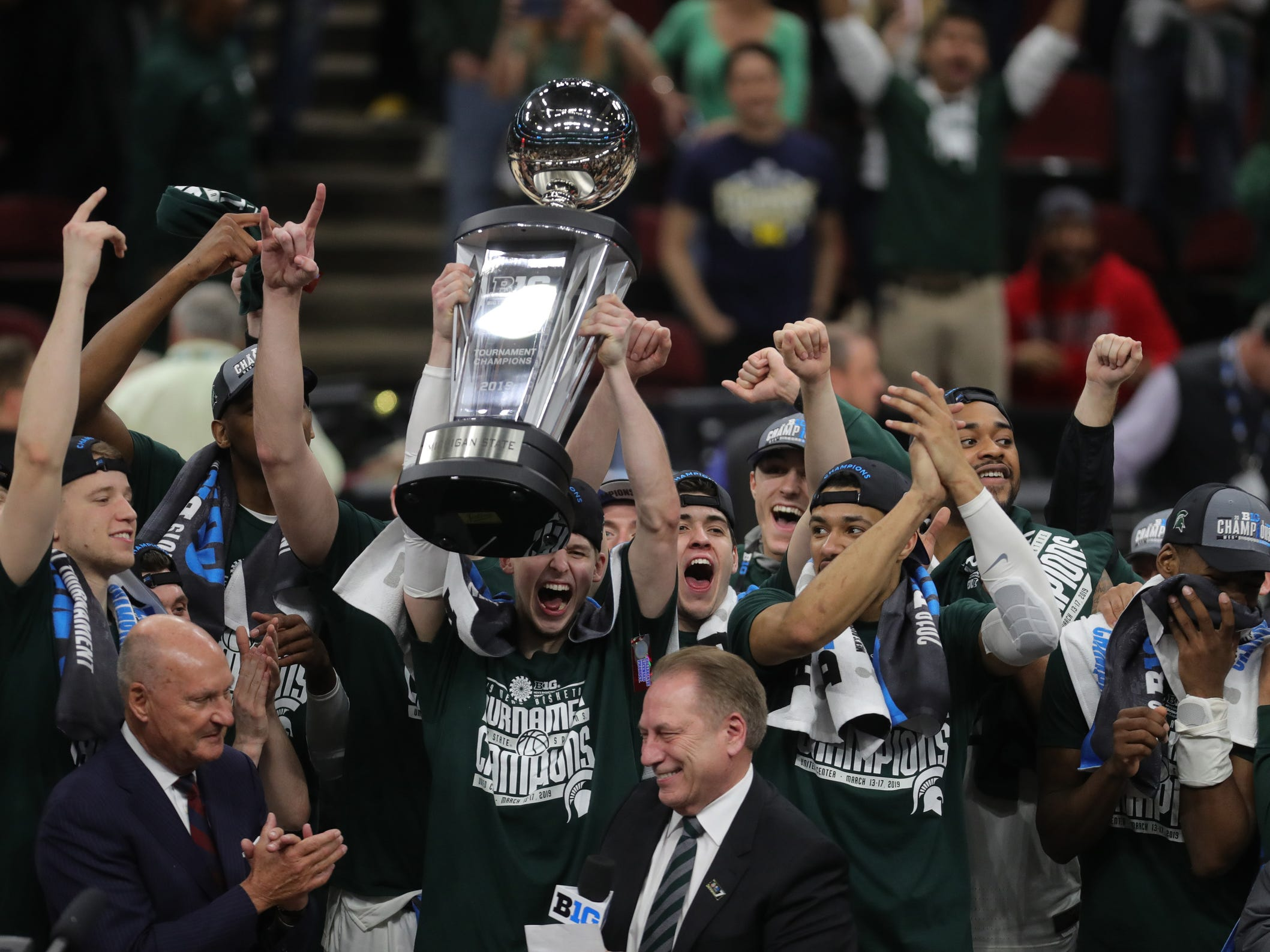 Matt McQuaid accepts the Big Ten tournament championship trophy after Michigan State defeated Michigan, 65-60, Sunday, March 17, 2019 at the United Center in Chicago.